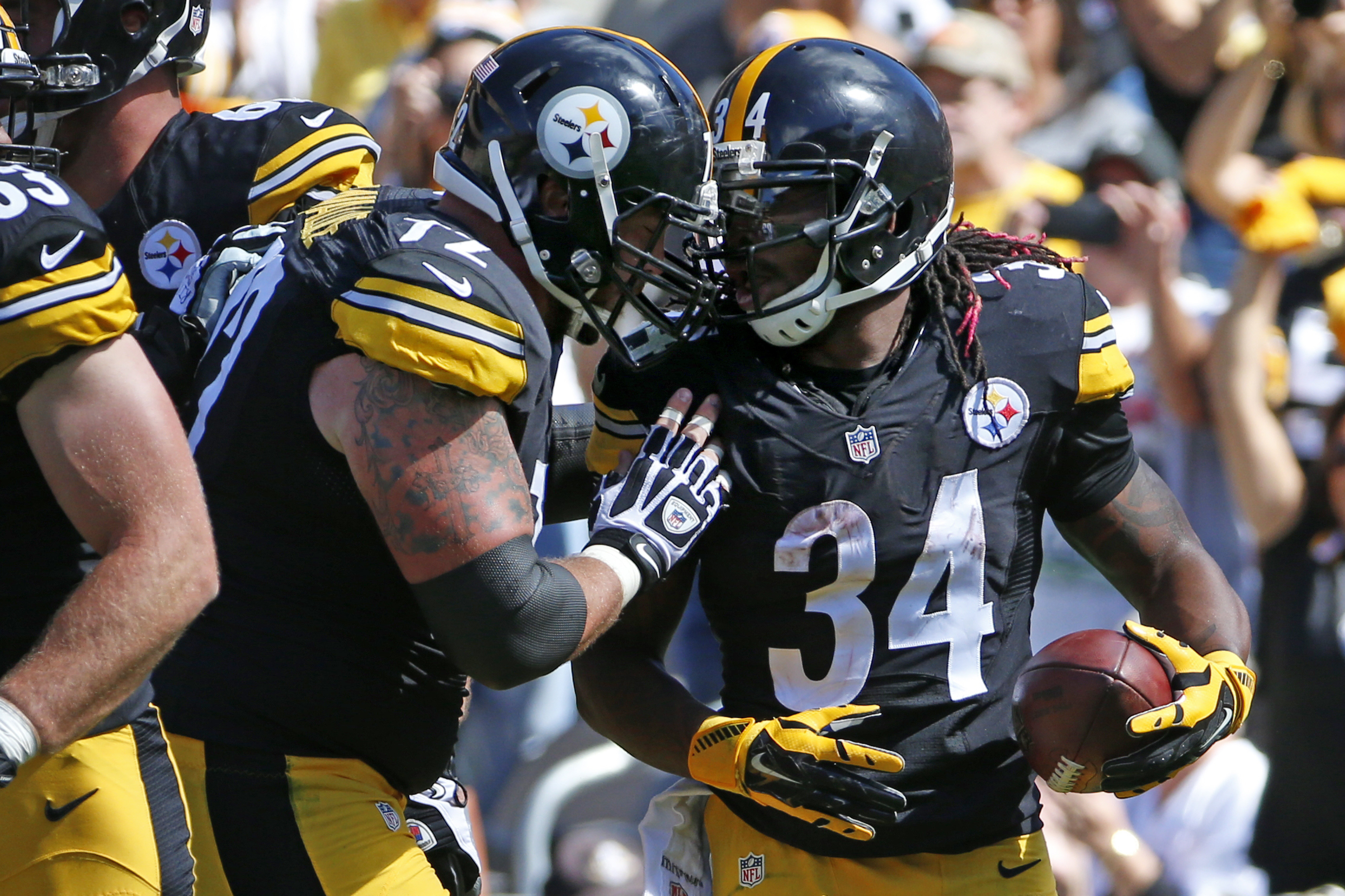 Pittsburgh Steelers running back DeAngelo Williams (34) is greeted by center Cody Wallace (72) after scoring a touchdown in the second quarter of an NFL football game against the San Francisco 49ers, Sunday, Sept. 20, 2015, in Pittsburgh. (AP Photo/Gene J