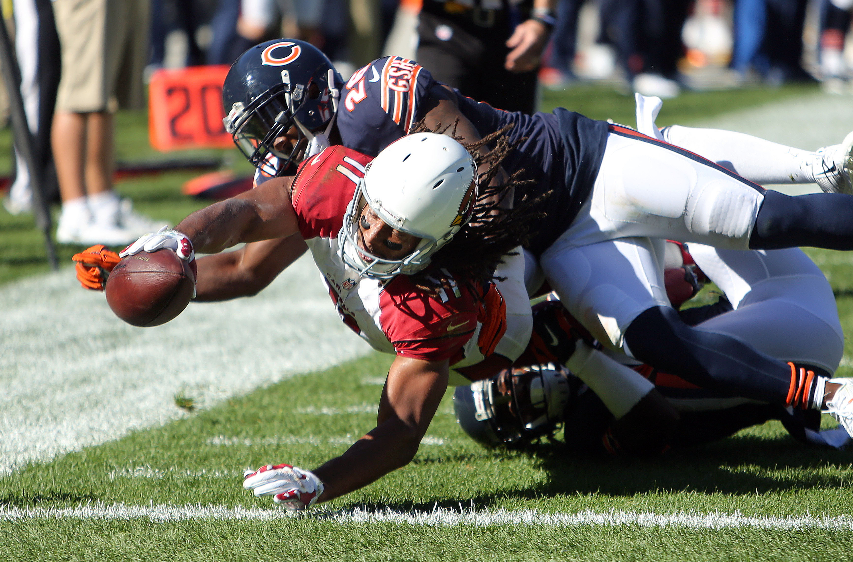 Arizona Cardinals wide receiver Larry Fitzgerald drags Chicago Bears cornerback Terrance Mitchell into the end zone during an NFL football game, Sunday, Sept. 20, 2015 in Chicago. (Steve Lundy/Daily Herald via AP) MANDATORY CREDIT; MAGS OUT