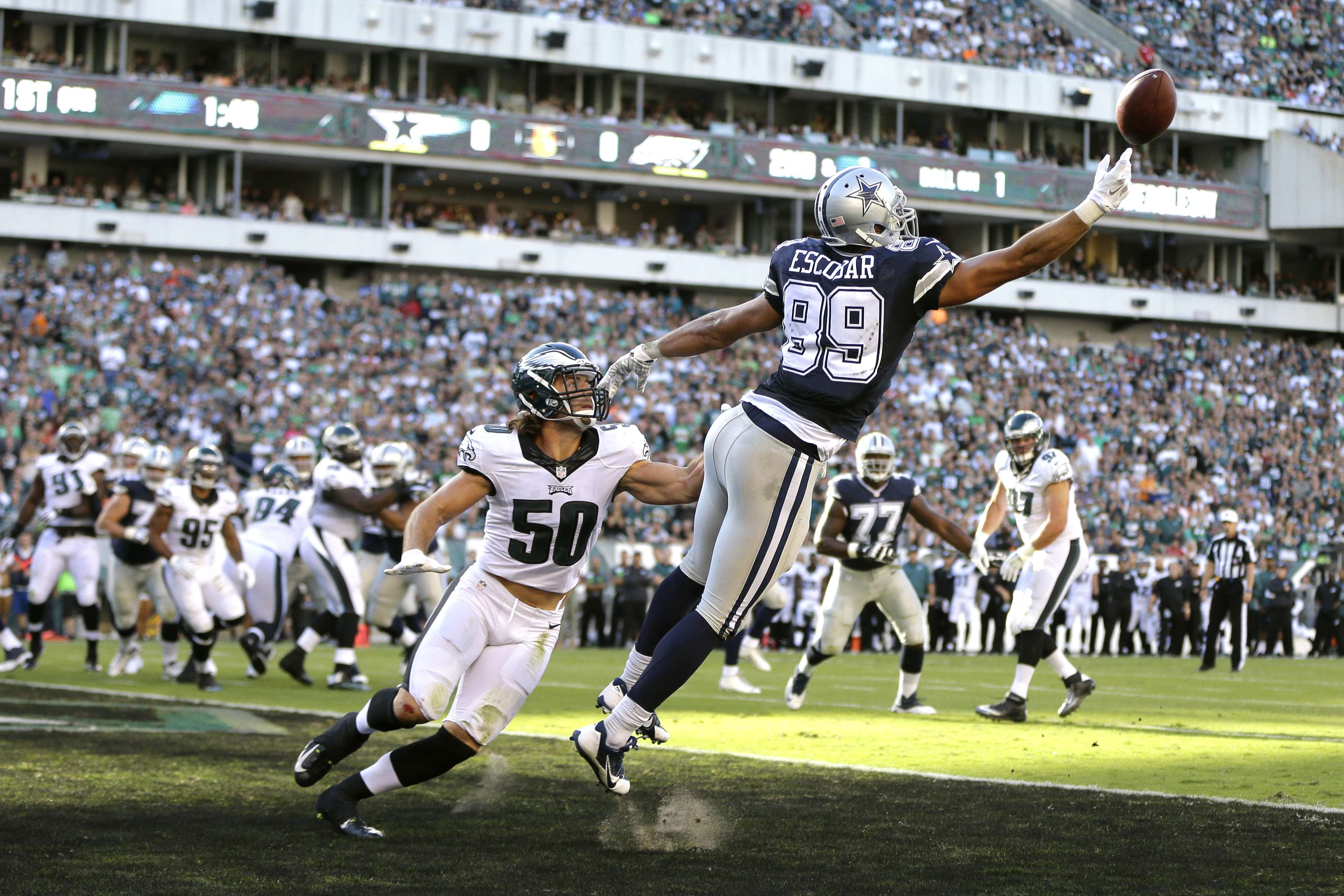Dallas Cowboys' Gavin Escobar (89) cannot reach a pass in the end zone as Philadelphia Eagles' Kiko Alonso (50) looks on during the first half of an NFL football game, Sunday, Sept. 20, 2015, in Philadelphia. (AP Photo/Matt Rourke)