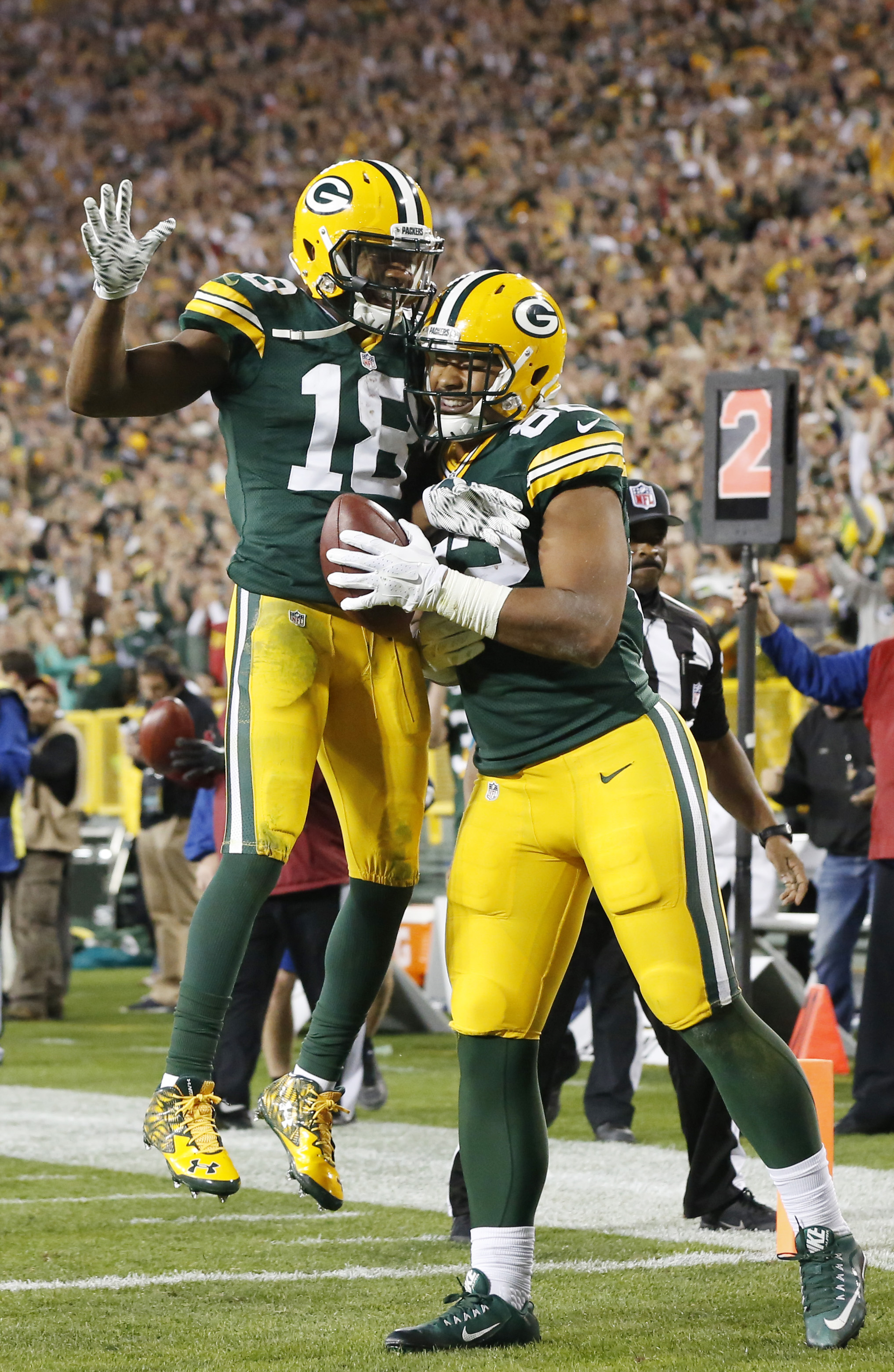 Green Bay Packers' Richard Rodgers is congratulated by Randall Cobb (18) after catching a touchdown pass during the second half of an NFL football game against the Seattle Seahawks Sunday, Sept. 20, 2015, in Green Bay, Wis. (AP Photo/Mike Roemer)