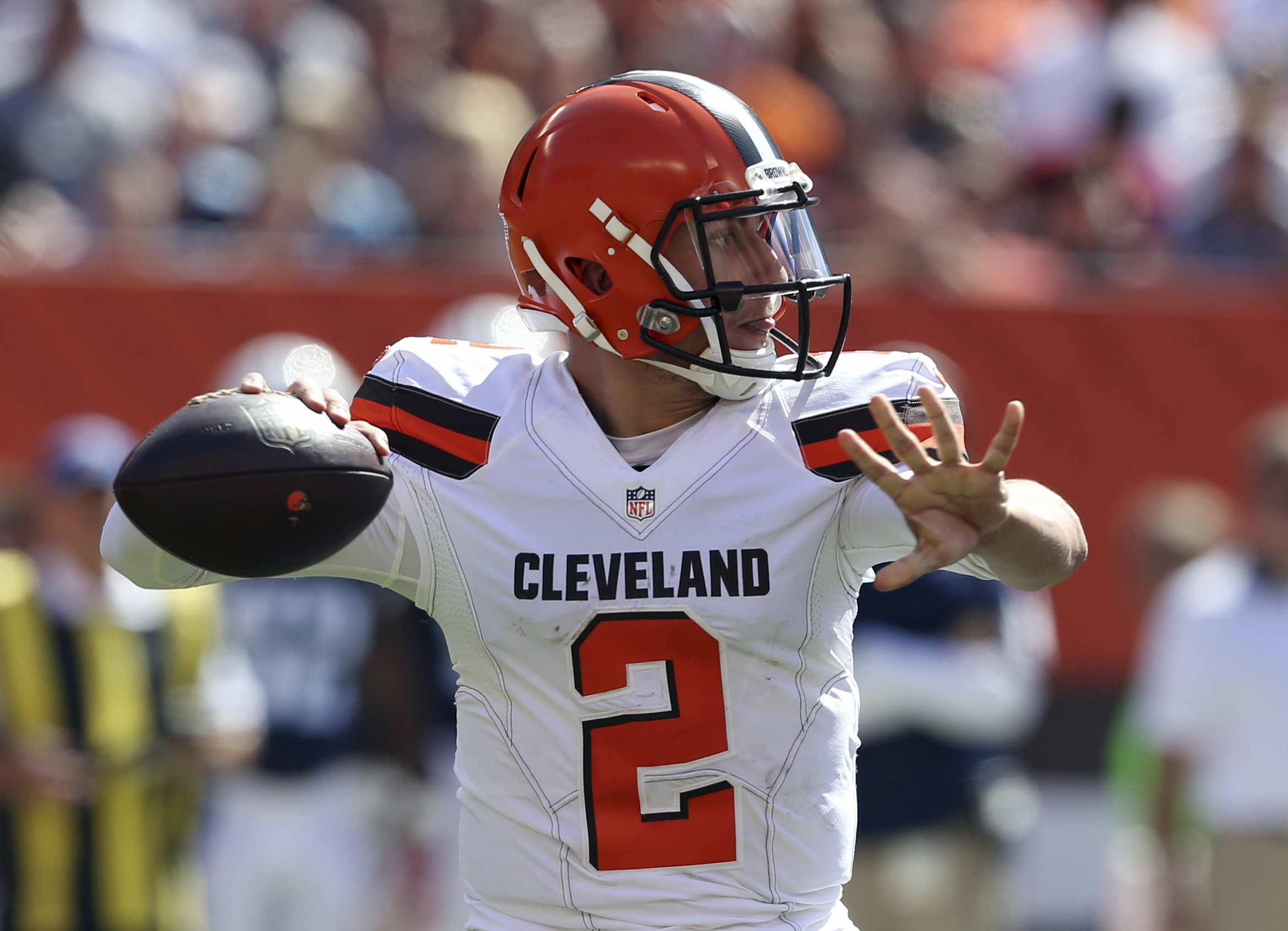 FILE - In this Sunday, Sept. 20, 2015 file photo, Cleveland Browns quarterback Johnny Manziel (2) looks to pass during the first half of an NFL football game against the Tennessee Titans in Cleveland. Manziel threw a 60-yard touchdown pass to Travis Benja