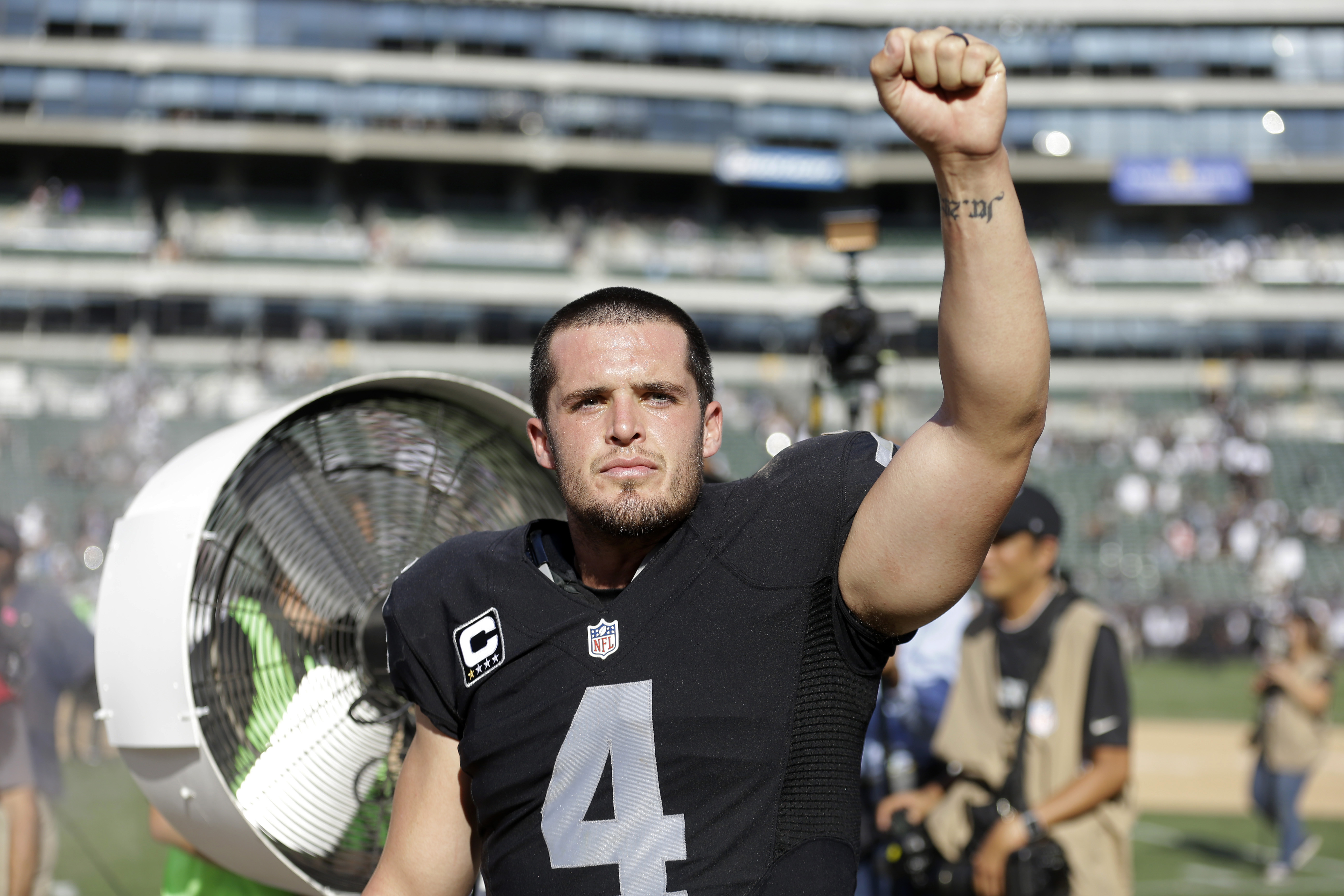 FILE - IN this Sept. 20, 2015 file photo, Oakland Raiders quarterback Derek Carr celebrates after a 37-33 win over the Baltimore Ravens during an NFL football game in Oakland, Calif. Carr threw a 12-yard touchdown pass to Seth Roberts with 26 seconds left