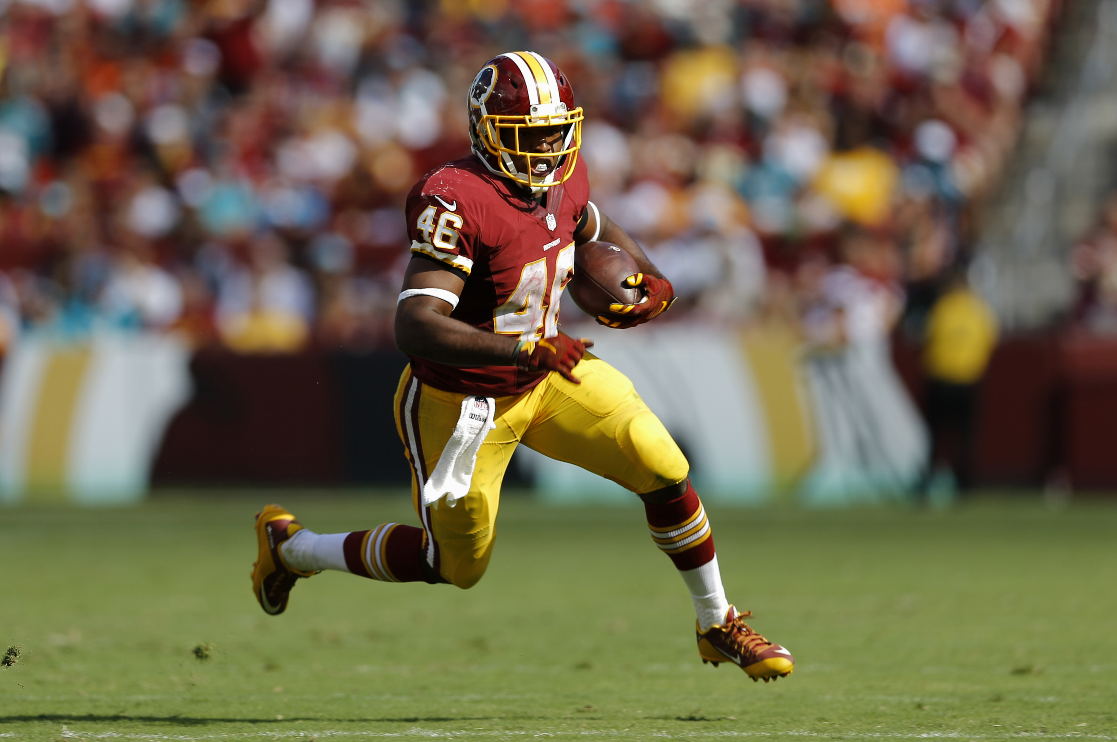 In this photo taken Sept. 13, 2015, Washington Redskins running back Alfred Morris rushes the ball during the second half of an NFL football game against the Miami Dolphins in Landover, Md. By adding rookie Matt Jones to dependable veteran Morris, the Was