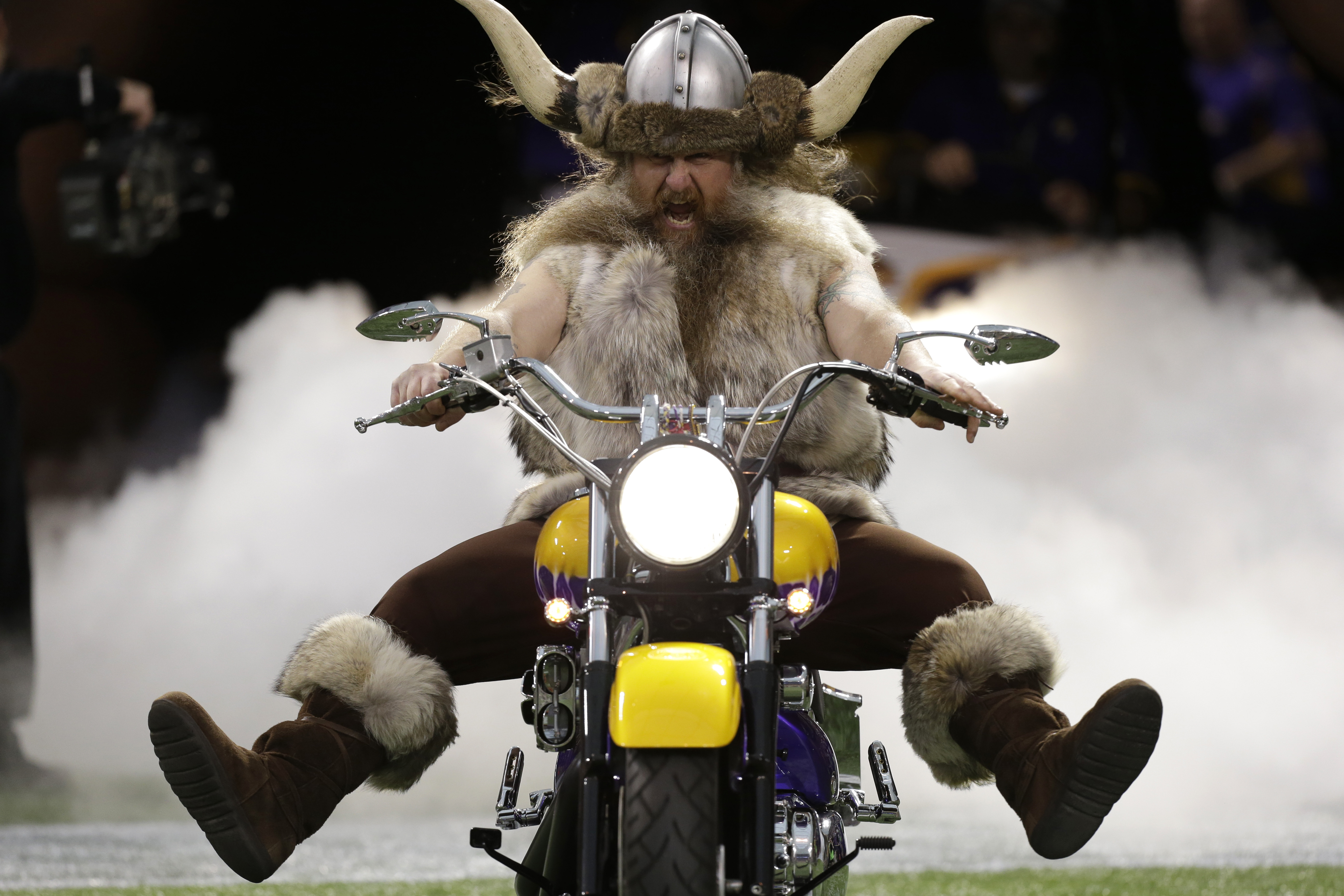 FILE - In this Nov. 11, 2012, file photo, Minnesota Vikings mascot Ragnar the Viking rides onto the field before an NFL football game between the Vikings and the Detroit Lions in Minneapolis. The Vikings said Monday, Sept. 21, 2015, their contract with Jo