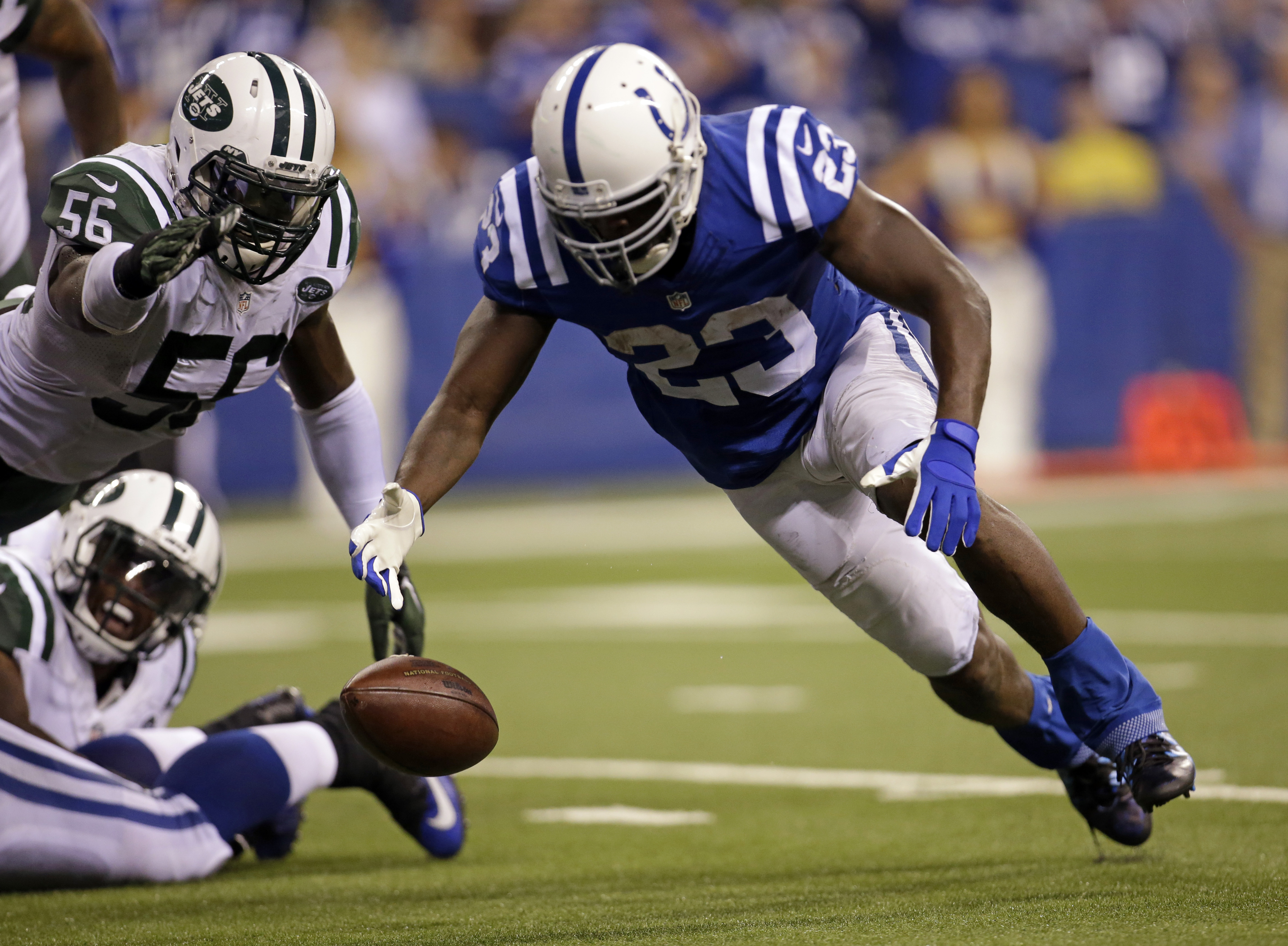 Indianapolis Colts running back Frank Gore (23) fumbles the ball on the one-yard line in front of New York Jets inside linebacker Demario Davis (56) during the second half of an NFL football game in Indianapolis, Monday, Sept. 21, 2015. (AP Photo/AJ Mast)