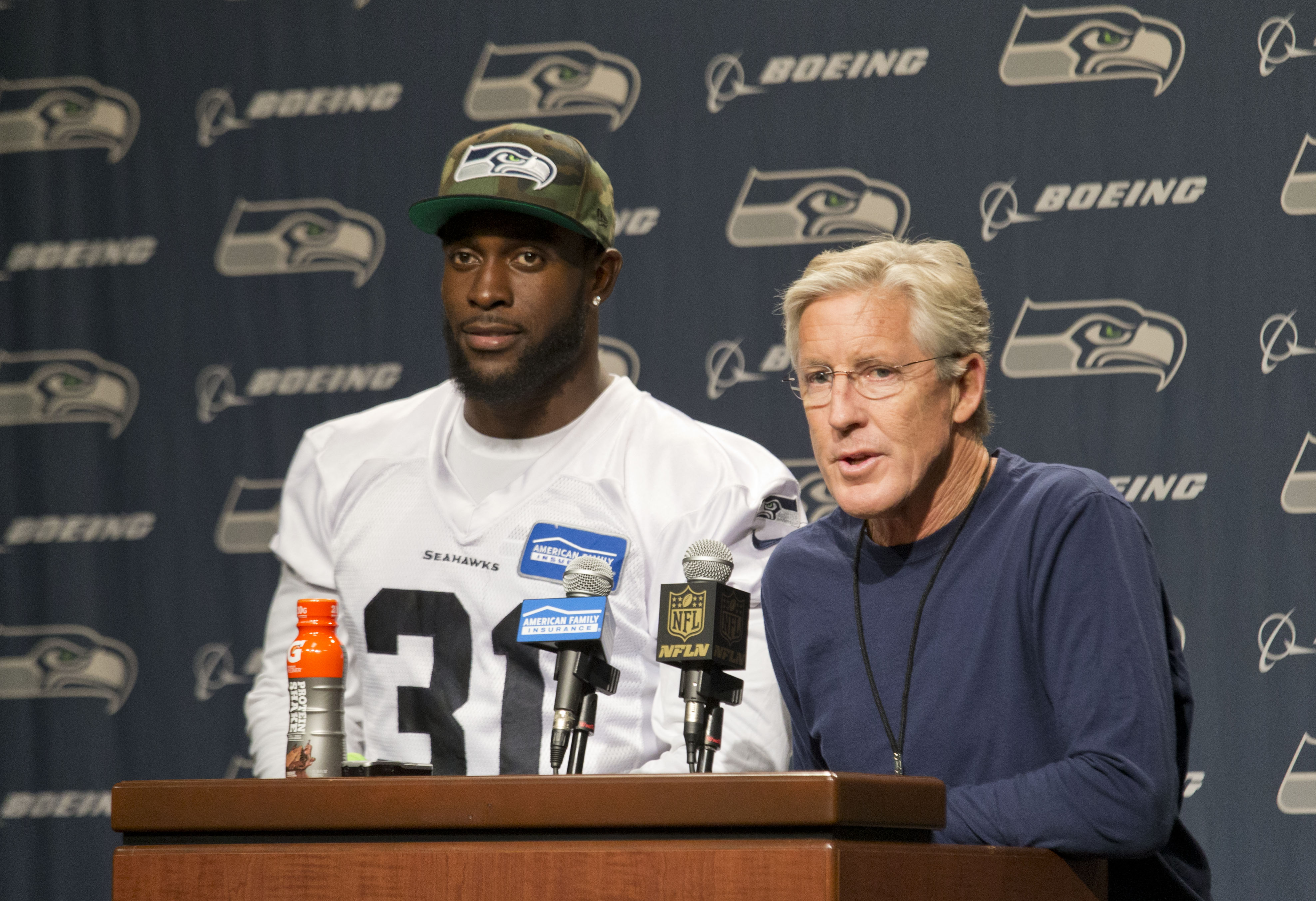 Seattle Seahawks' Kam Chancellor, left, and head coach Pete Carroll talk about Chancellor's return to the team after holding out over a contract dispute, during NFL football news conference at the team's headquarters in Renton, Wash., Wednesday, Sept. 23,