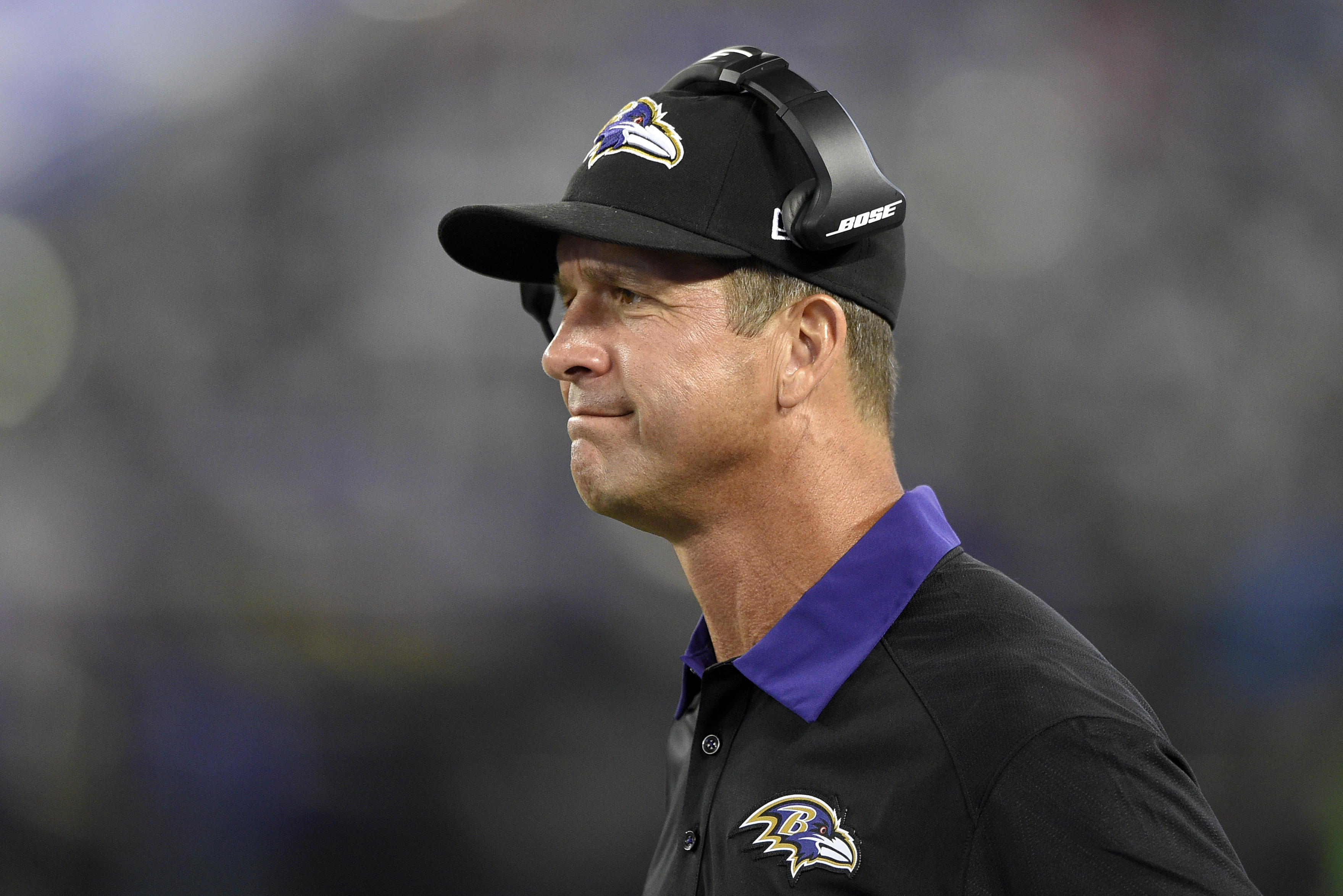 FILE - In this Aug. 29, 2015, file photo, Baltimore Ravens head coach John Harbaugh watches from the sideline in the second half of a preseason NFL football game against the Washington Redskins in Baltimore. USA Football's successful program teaching the