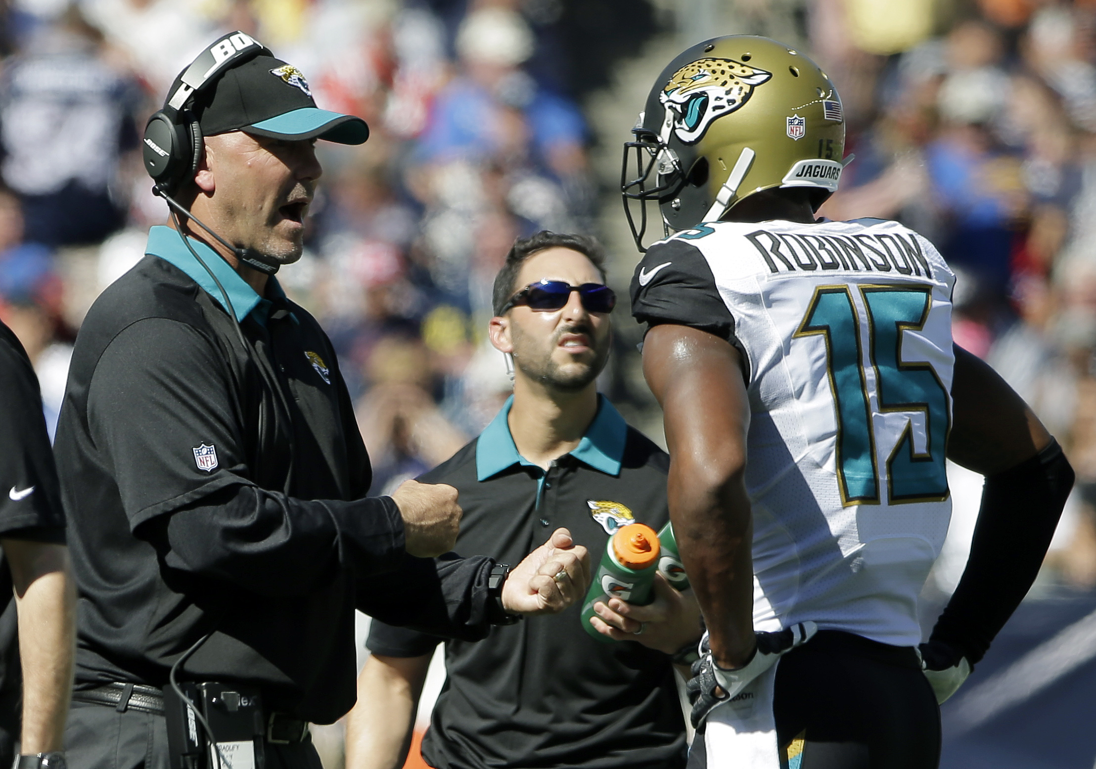 Jacksonville Jaguars head coach Gus Bradley, left, talks to wide receiver Allen Robinson in the first half of an NFL football game, Sunday, Sept. 27, 2015, in Foxborough, Mass. (AP Photo/Steven Senne)