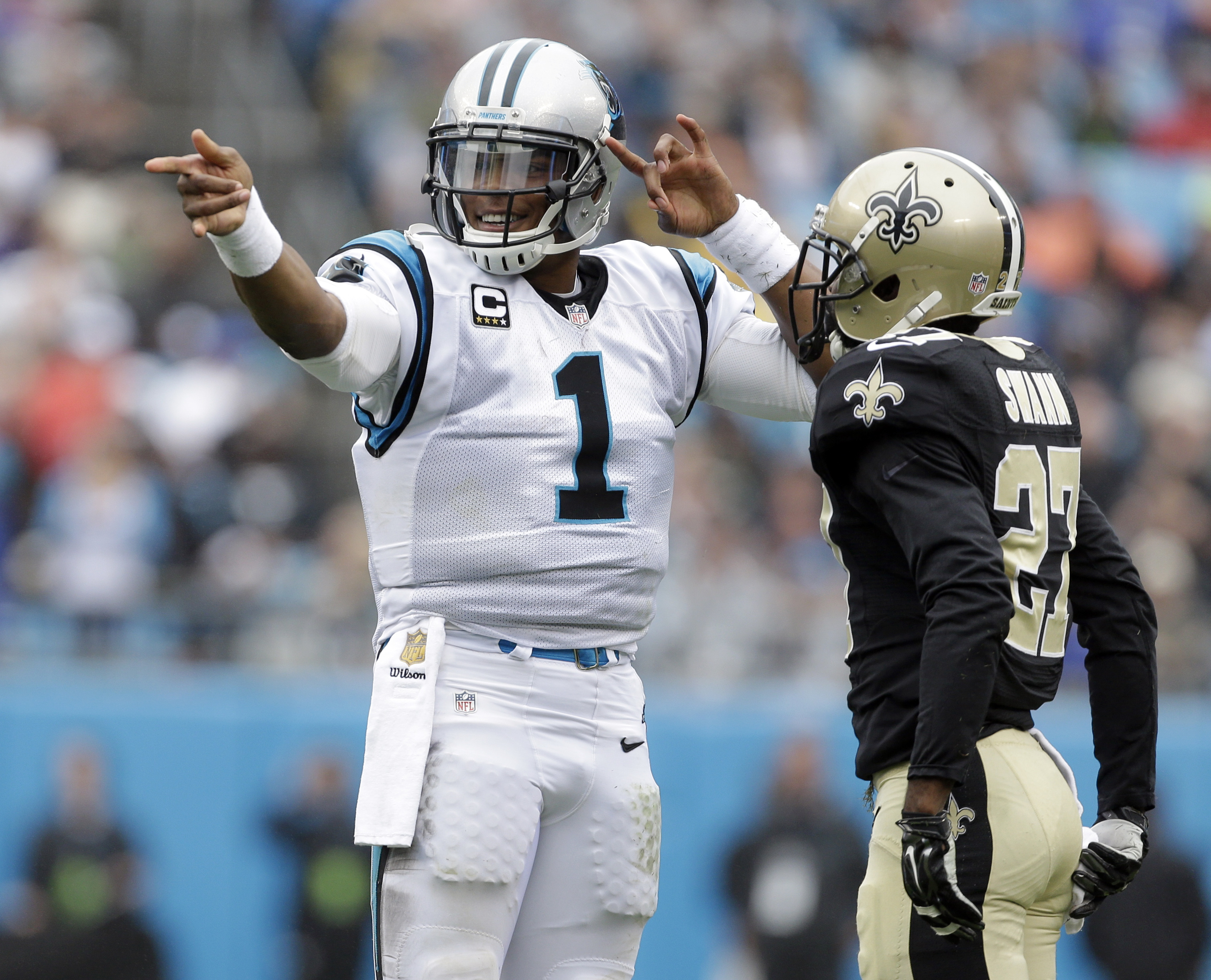 Carolina Panthers' Cam Newton (1) celebrates a first down in front of New Orleans Saints' Damian Swann (27) in the first half of an NFL football game in Charlotte, N.C., Sunday, Sept. 27, 2015. (AP Photo/Bob Leverone)