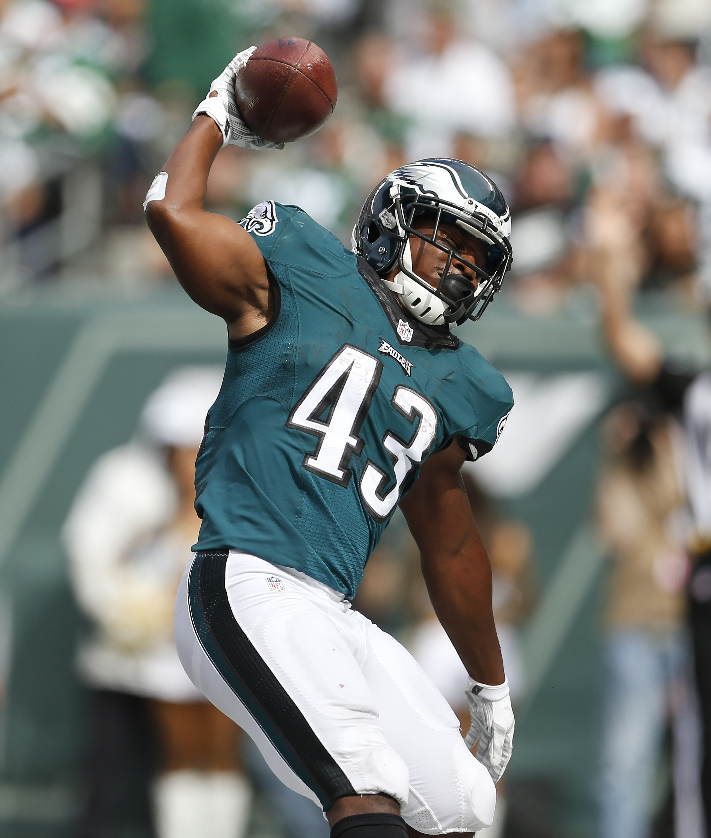 Philadelphia Eagles running back Darren Sproles (43) celebrates after scoring a touchdown against the New York Jets during the second quarter of an NFL football game, Sunday, Sept. 27, 2015, in East Rutherford, N.J. (AP Photo/Adam Hunger)