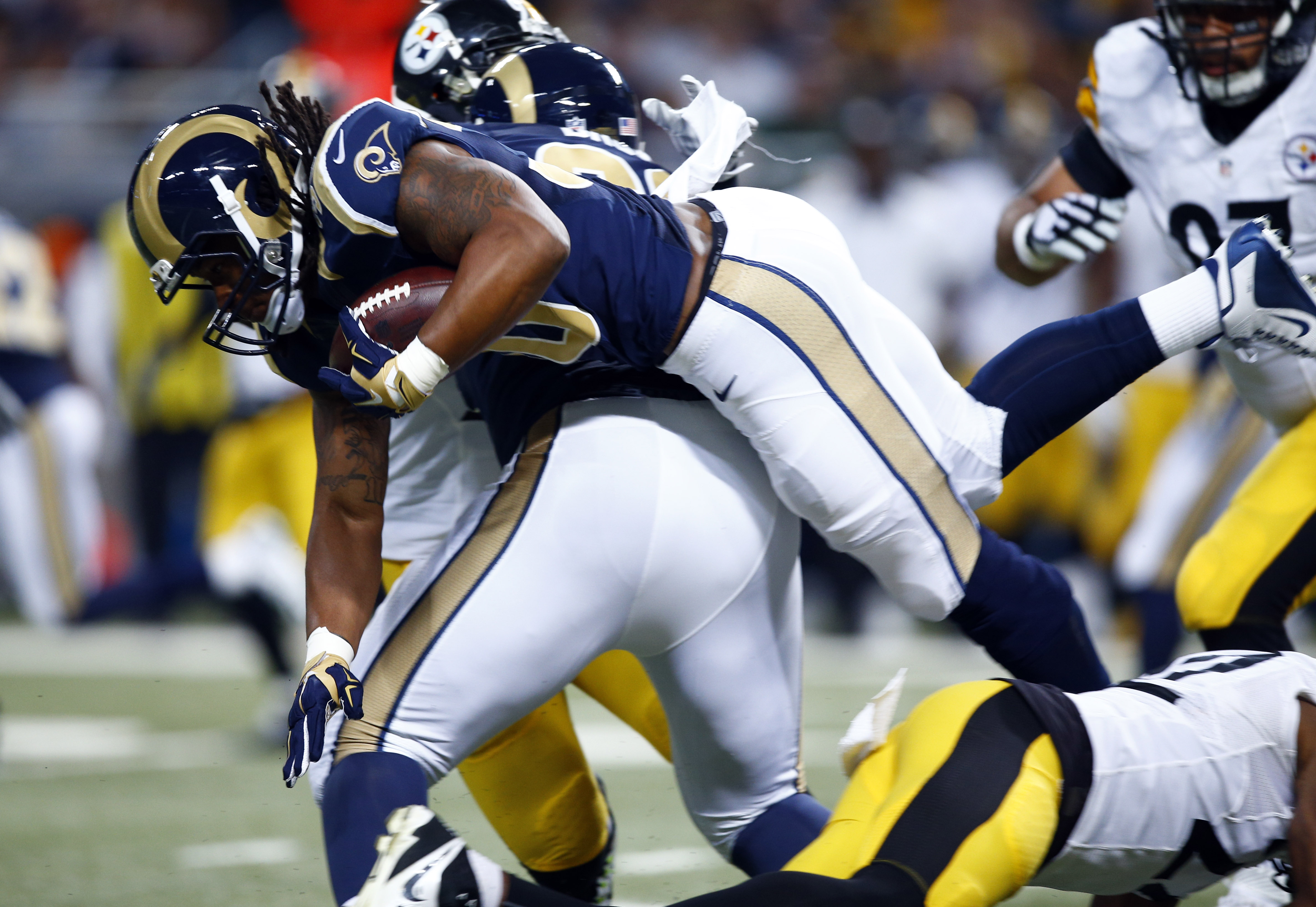 St. Louis Rams running back Todd Gurley runs the ball during the second quarter of an NFL football game against the Pittsburgh Steelers, Sunday, Sept. 27, 2015, in St. Louis. (AP Photo/Billy Hurst)