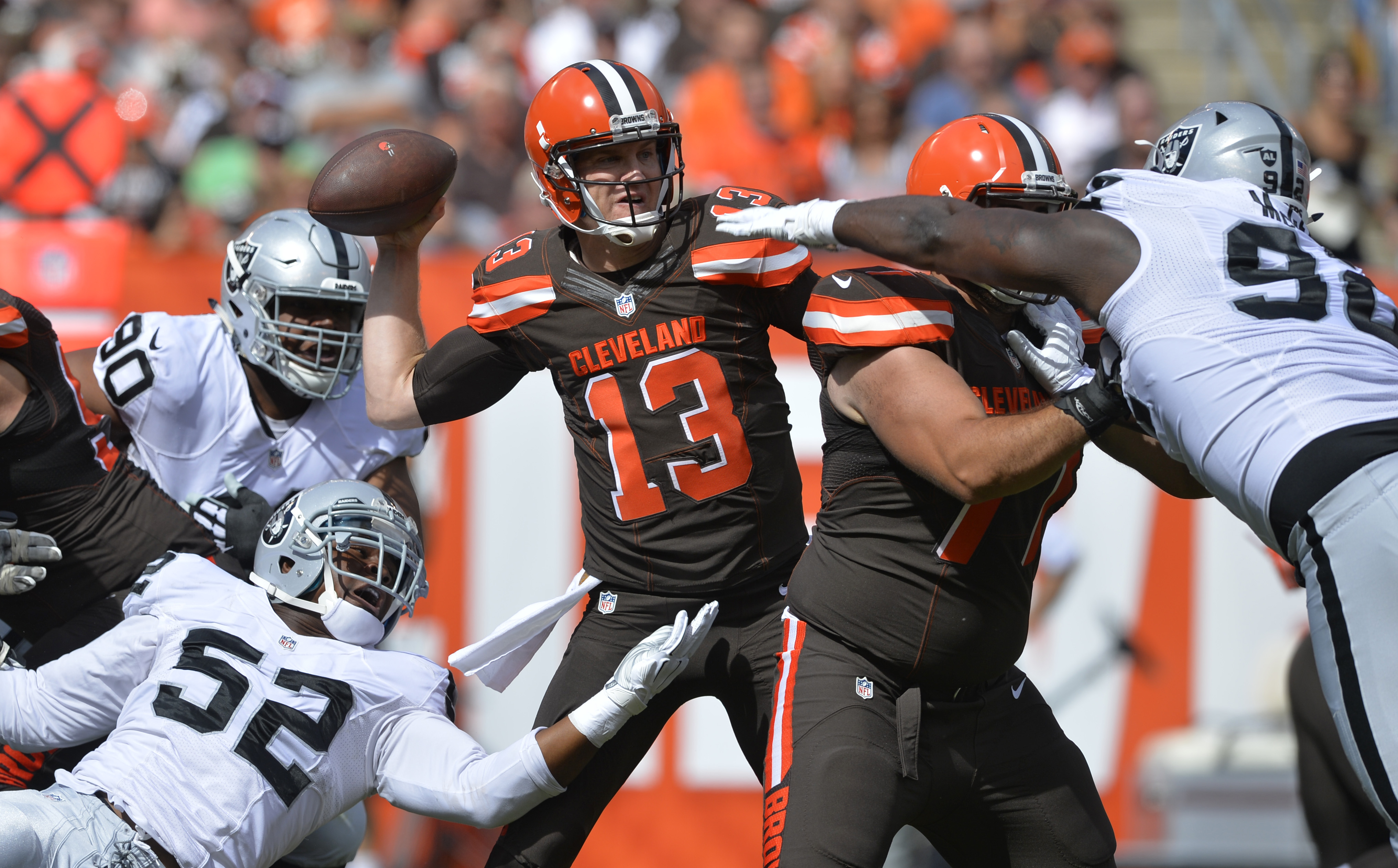 Cleveland Browns quarterback Josh McCown (13) throws against the Oakland Raiders during an NFL football game, Sunday, Sept. 27, 2015, in Cleveland. (AP Photo/David Richard)