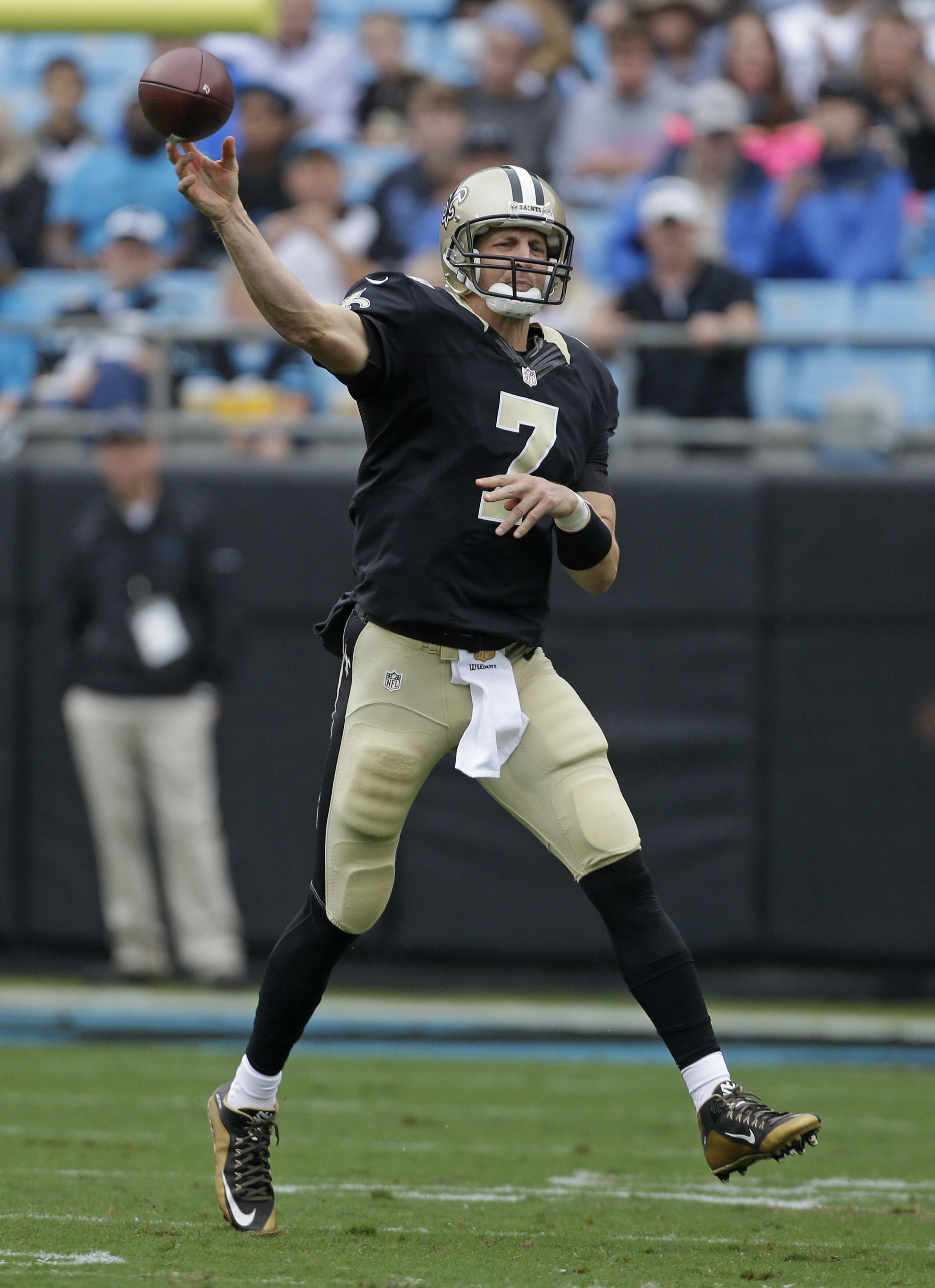 New Orleans Saints' Luke McCown (7) throws a pass against the Carolina Panthers in the first half of an NFL football game in Charlotte, N.C., Sunday, Sept. 27, 2015. (AP Photo/Bob Leverone)