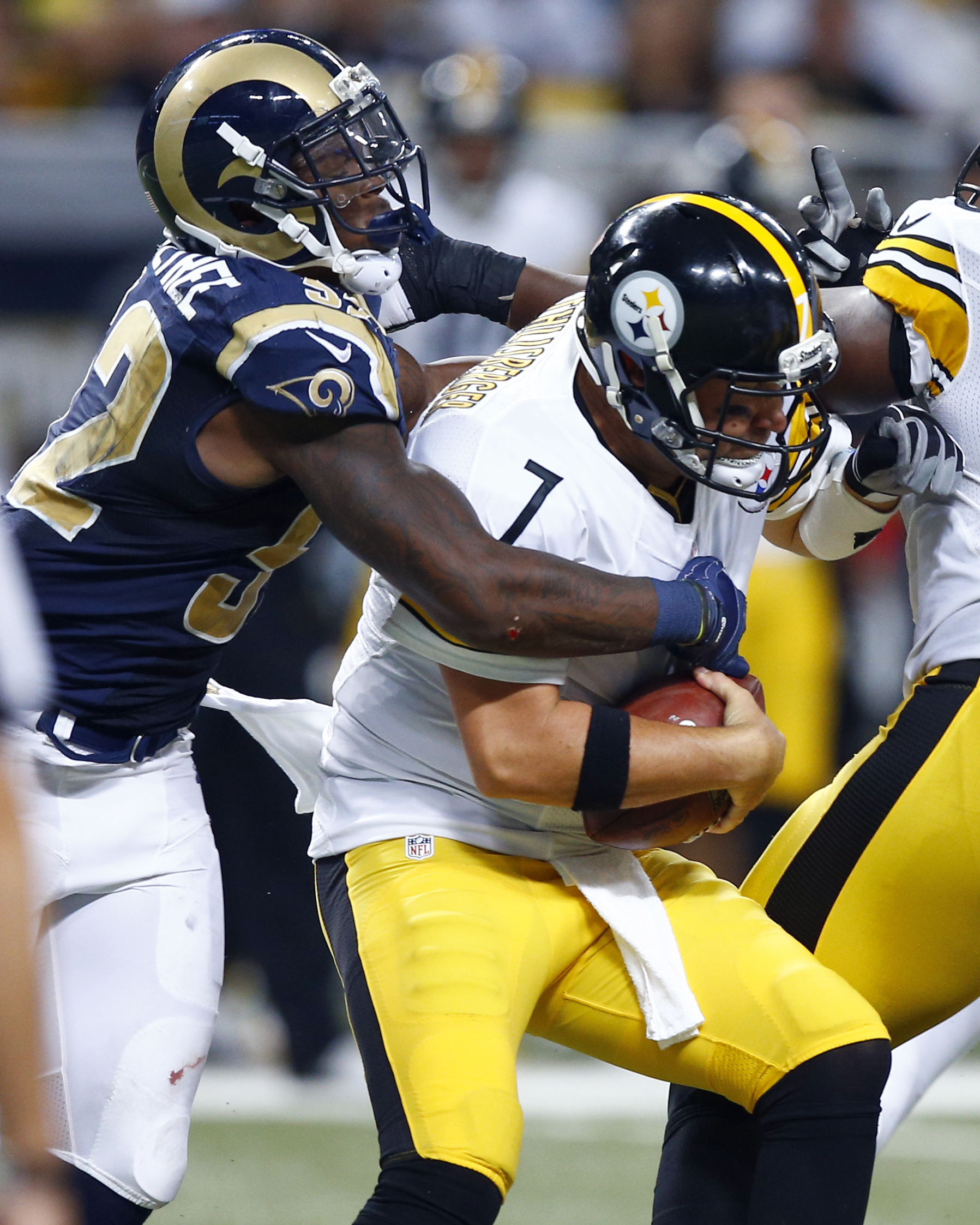 Pittsburgh Steelers quarterback Ben Roethlisberger, right, is sacked by St. Louis Rams linebacker Alec Ogletree during the second quarter of an NFL football game, Sunday, Sept. 27, 2015, in St. Louis. (AP Photo/Billy Hurst)