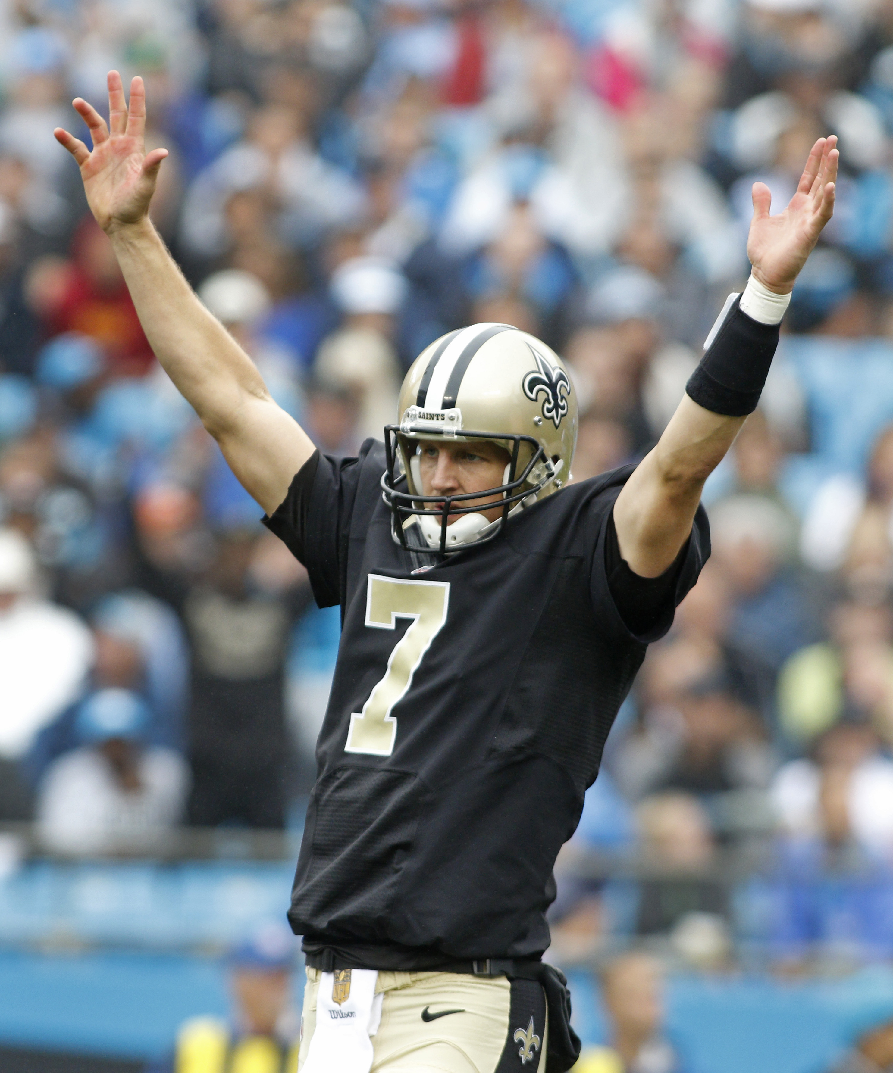 New Orleans Saints' Luke McCown (7) celebrates a touchdown against the Carolina Panthers in the first half of an NFL football game in Charlotte, N.C., Sunday, Sept. 27, 2015. (AP Photo/Bob Leverone)