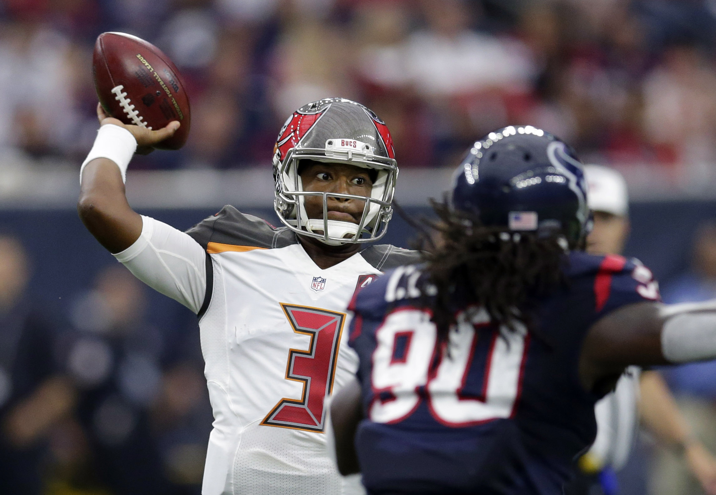 Tampa Bay Buccaneers' Jameis Winston (3) throws as Houston Texans' Jadeveon Clowney (90) applies pressure during the first half of an NFL football game Sunday, Sept. 27, 2015, in Houston. (AP Photo/David J. Phillip)