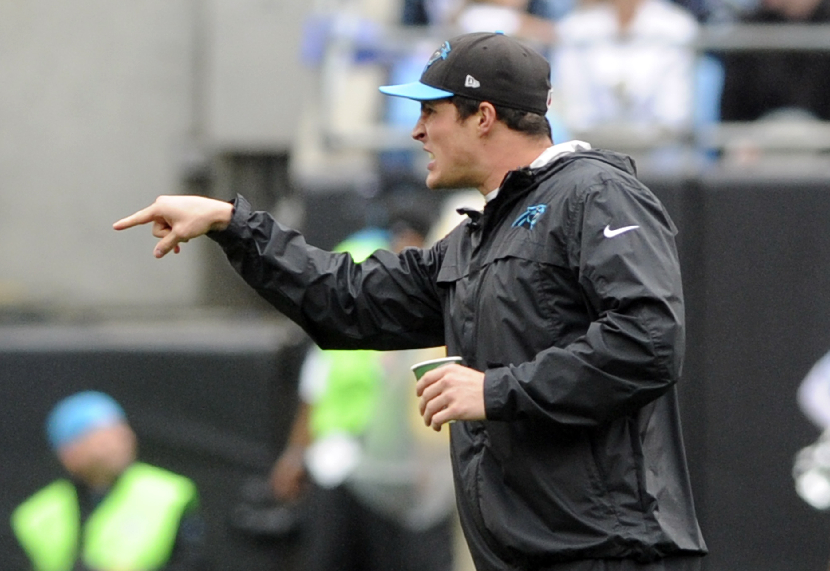 Carolina Panthers' Luke Kuechly shouts to teammates from the sideline in the first half of an NFL football game against the New Orleans Saints in Charlotte, N.C., Sunday, Sept. 27, 2015. (AP Photo/Mike McCarn)