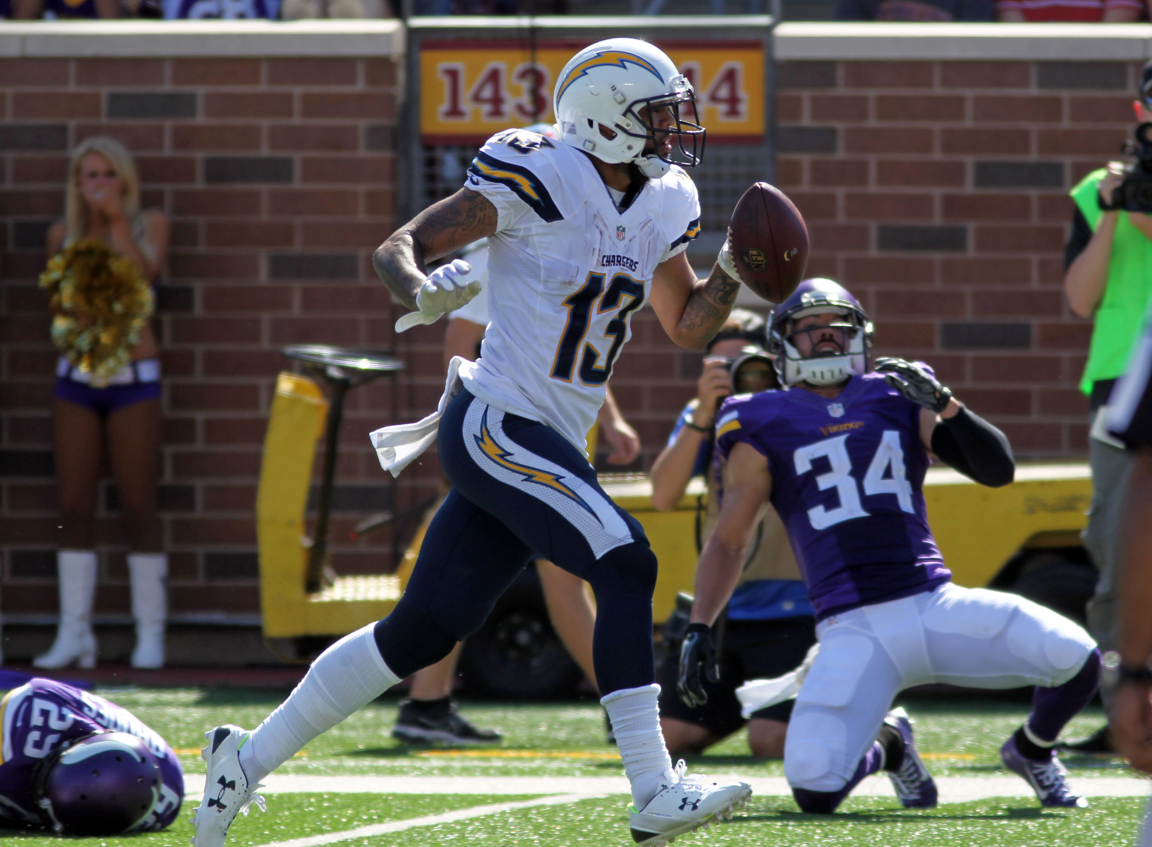 San Diego Chargers wide receiver Keenan Allen (13) scores a touchdown in front of Minnesota Vikings strong safety Andrew Sendejo (34) in the first half of an NFL football game in Minneapolis, Sunday, Sept. 27, 2015. (AP Photo/Andy Clayton-King)