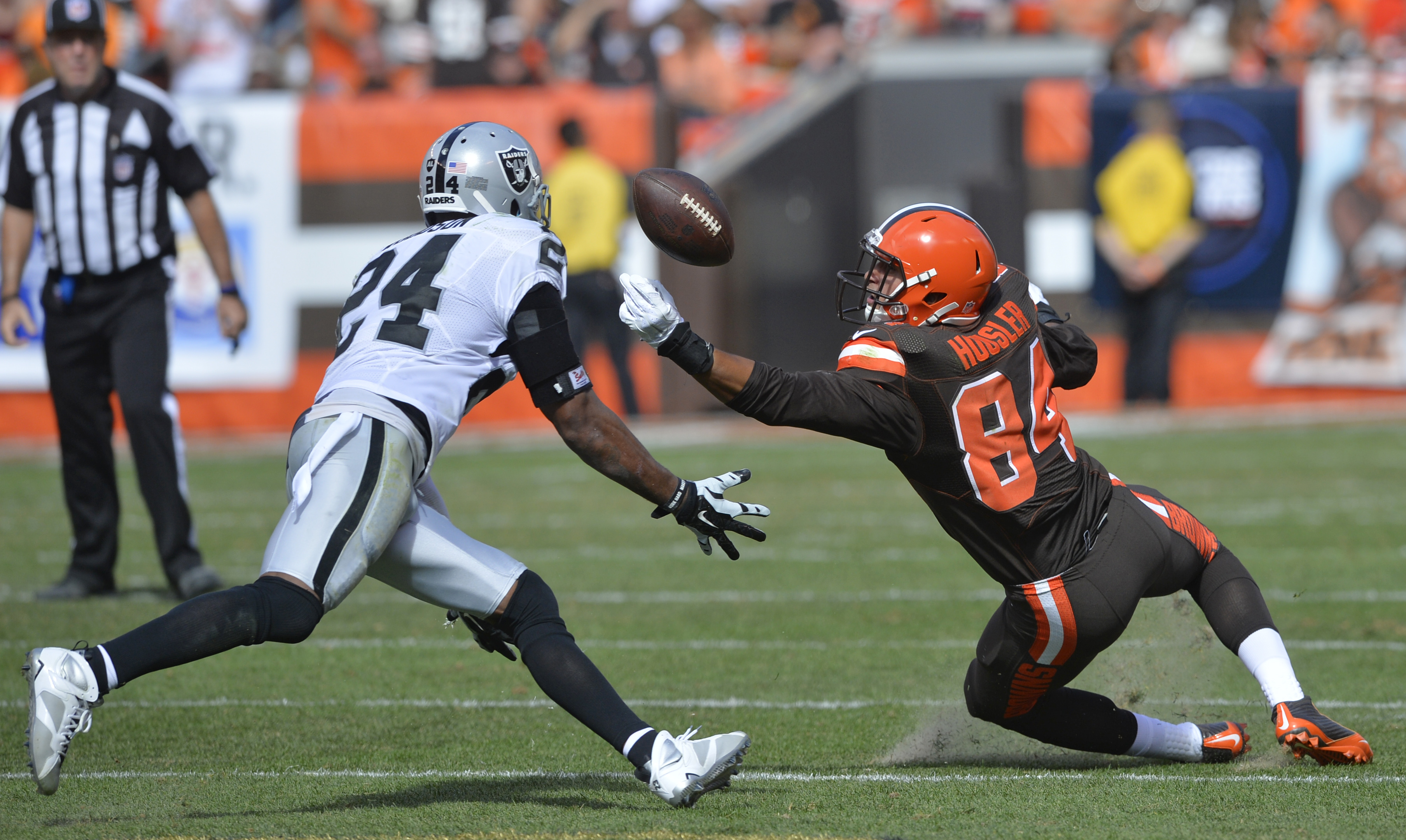 Cleveland Browns tight end Rob Housler (84) cannot catch a pass under pressure from Oakland Raiders free safety Charles Woodson (24) during the second half of an NFL football game, Sunday, Sept. 27, 2015, in Cleveland. (AP Photo/David Richard)