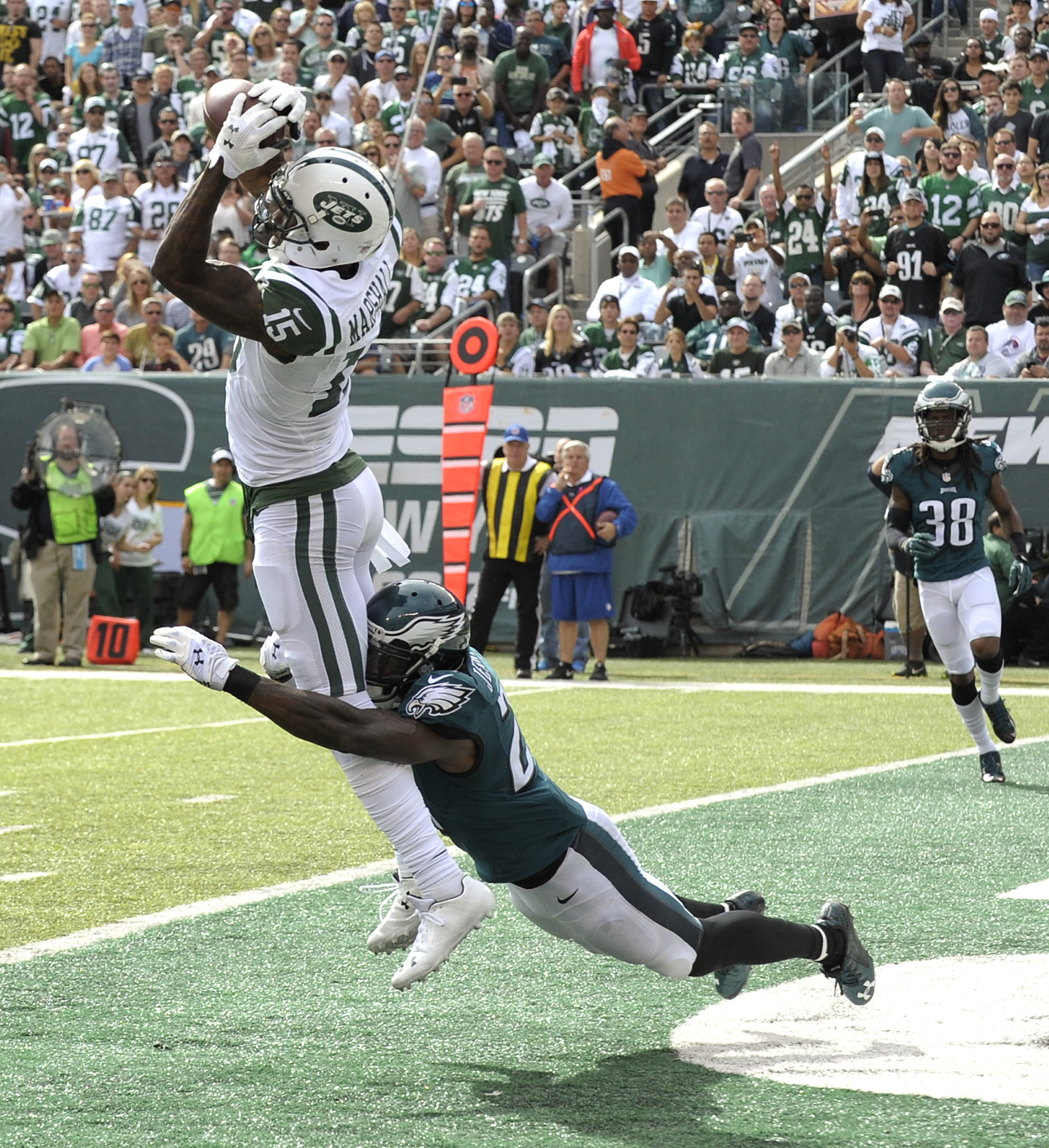 New York Jets wide receiver Brandon Marshall (15) makes a touchdown catch defended by Philadelphia Eagles free safety Malcolm Jenkins (27) during the second quarter of an NFL football game, Sunday, Sept. 27, 2015, in East Rutherford, N.J. (AP Photo/Bill K