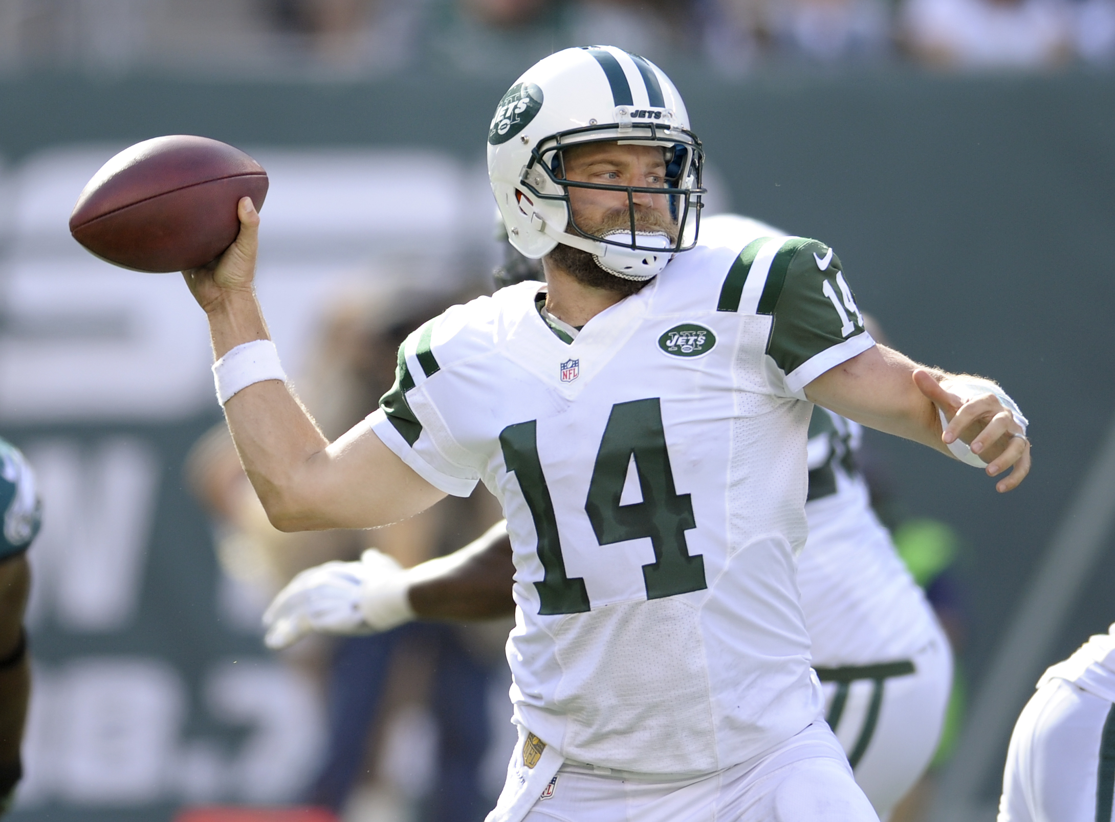 New York Jets quarterback Ryan Fitzpatrick (14) throws a pass against the Philadelphia Eagles during the fourth quarter of an NFL football game, Sunday, Sept. 27, 2015, in East Rutherford, N.J. (AP Photo/Bill Kostroun)