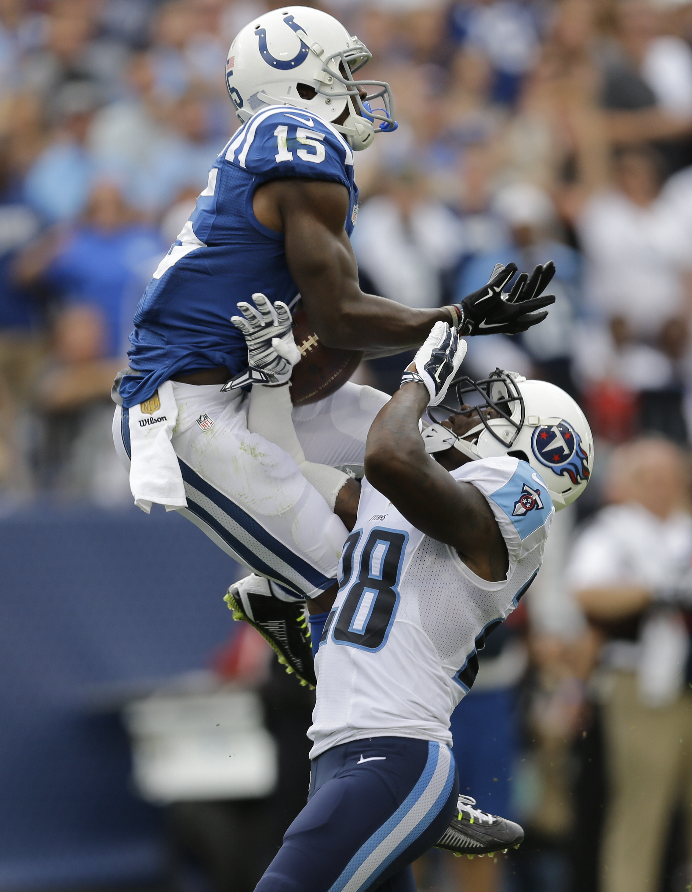 Indianapolis Colts wide receiver Phillip Dorsett (15) catches a 35-yard touchdown pass as he is defended by Tennessee Titans strong safety Marqueston Huff (28) in the second half of an NFL football game Sunday, Sept. 27, 2015, in Nashville, Tenn. (AP Phot