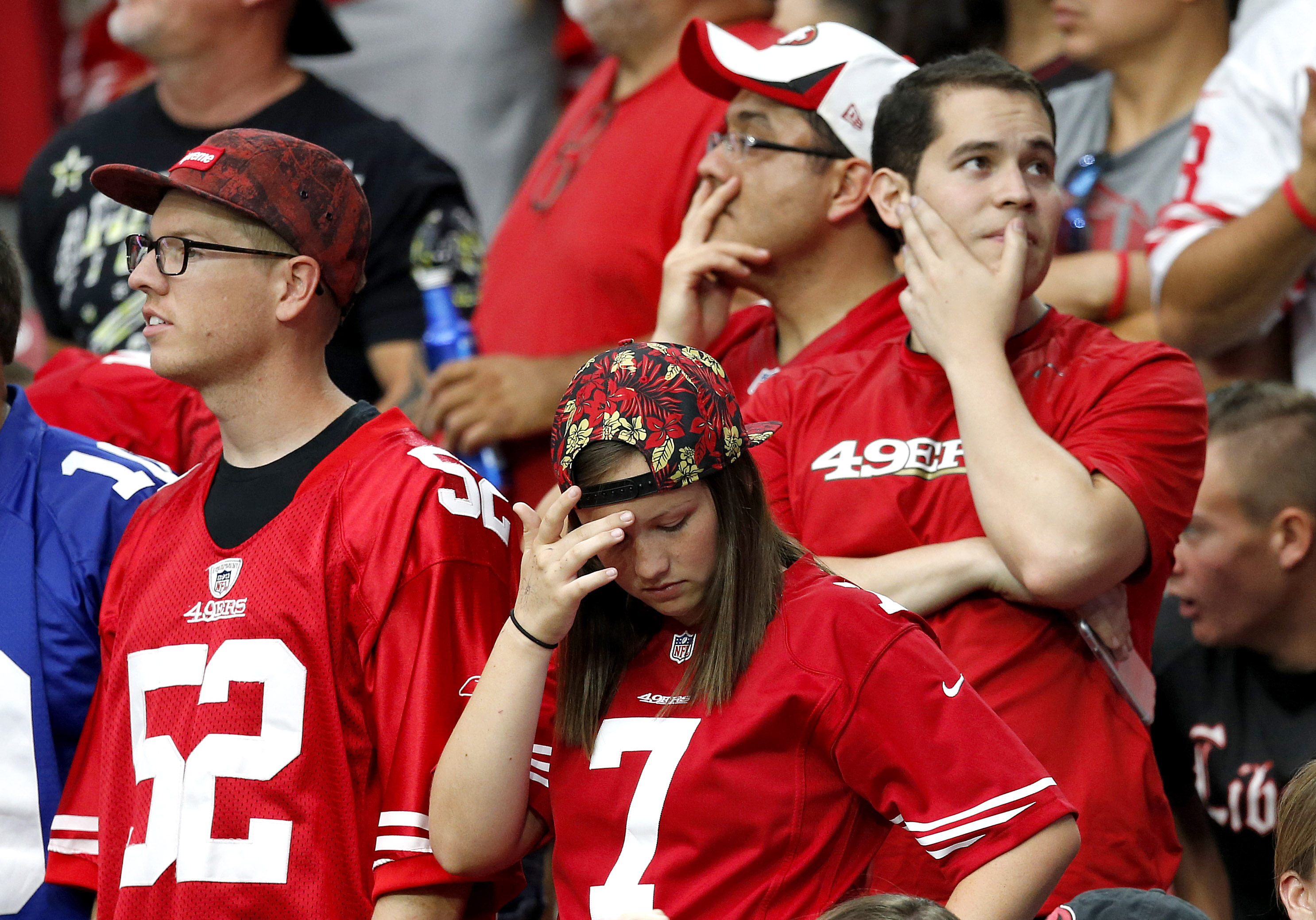 San Francisco 49ers fans react during the first half of an NFL football game against the Arizona Cardinals, Sunday, Sept. 27, 2015, in Glendale, Ariz.  (AP Photo/Ross D. Franklin)