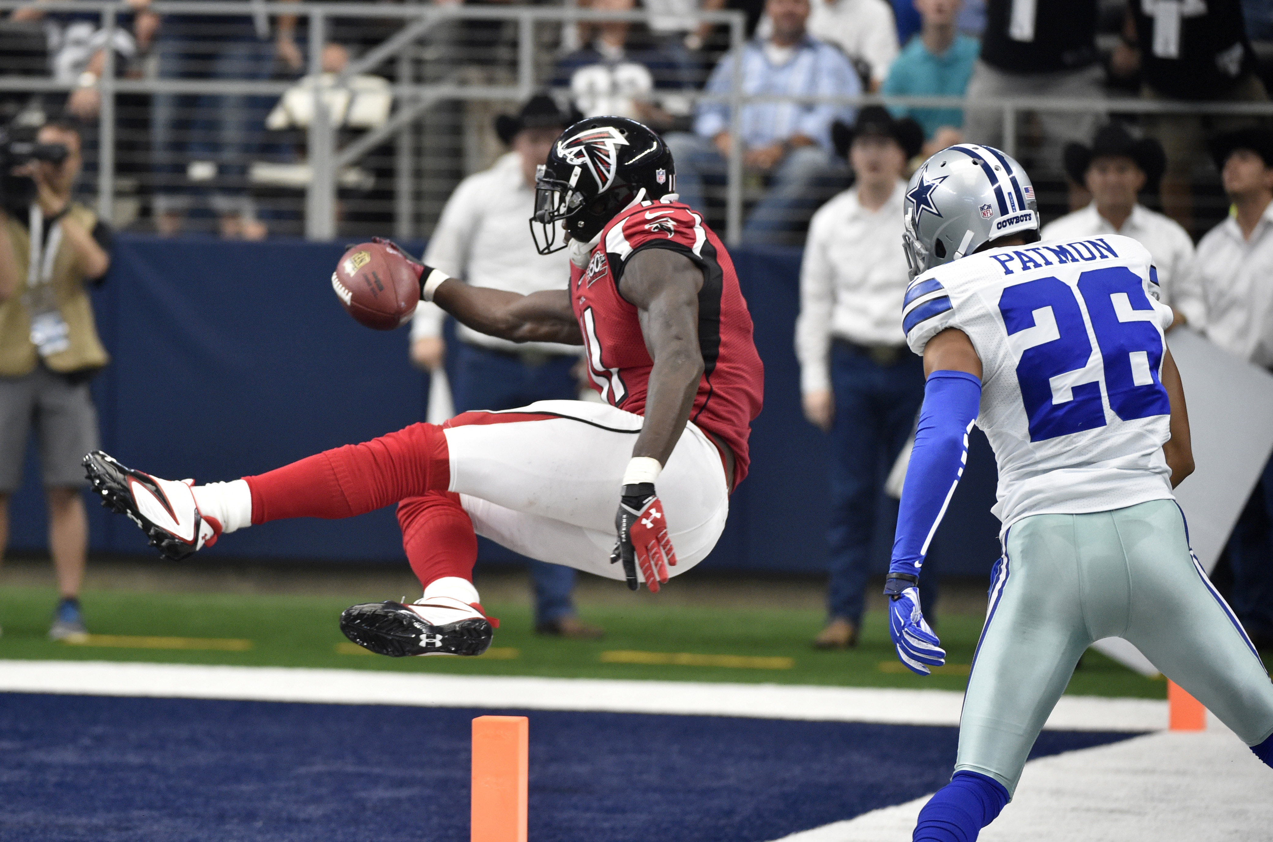 FILE - IN this Sept. 27, 2015 file photo, Atlanta Falcons wide receiver Julio Jones (11) sails into the end zone for a touchdown as Dallas Cowboys defensive back Tyler Patmon (26) watches in the second half of an NFL football game  in Arlington, Texas.  C