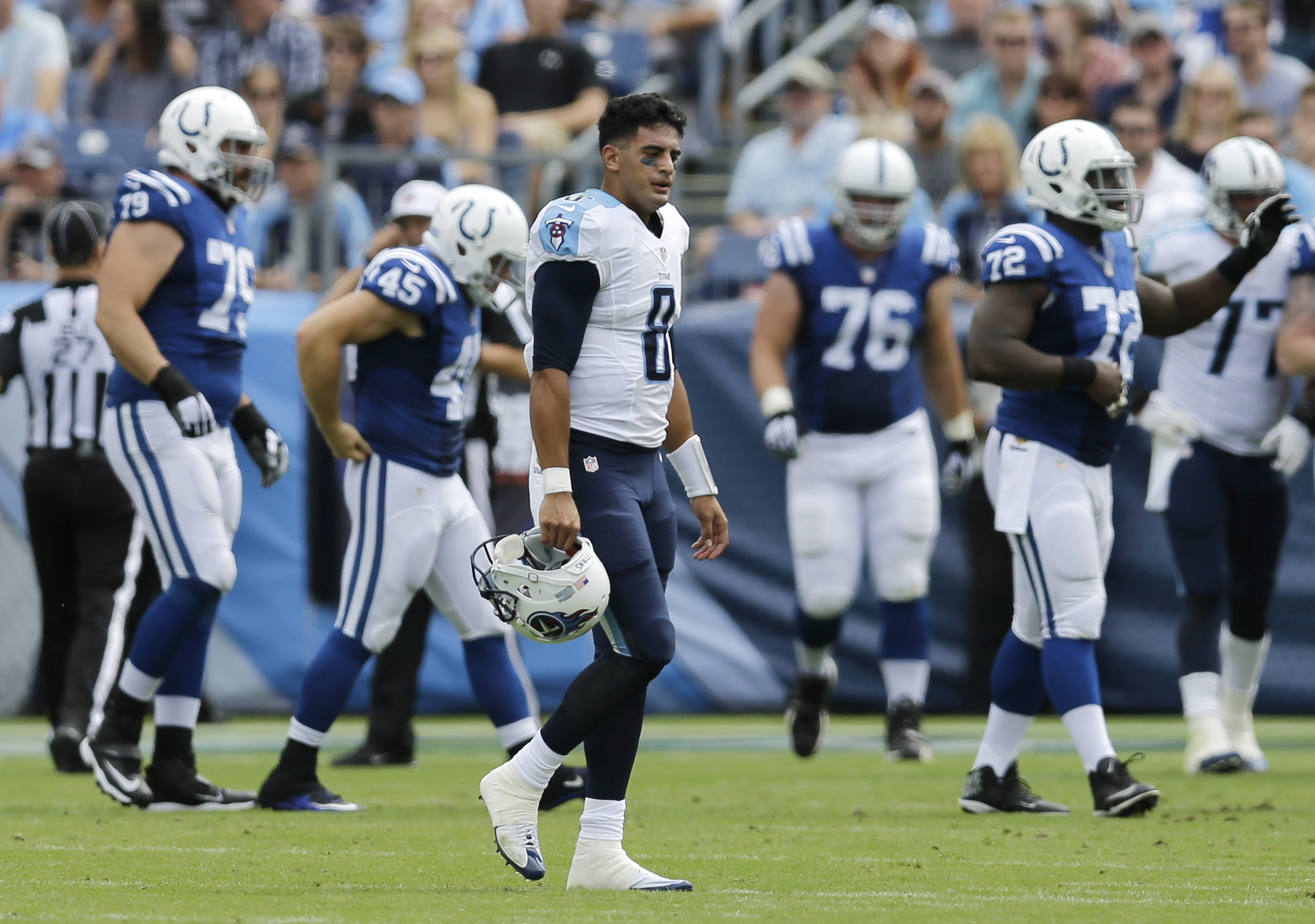 FILE - In this Sunday, Sept. 27, 2015 file photo, Tennessee Titans quarterback Marcus Mariota (8) walks off the field after Indianapolis Colts safety Dwight Lowery intercepted a pass and returned it 69 yards for a touchdown in the first half of an NFL foo