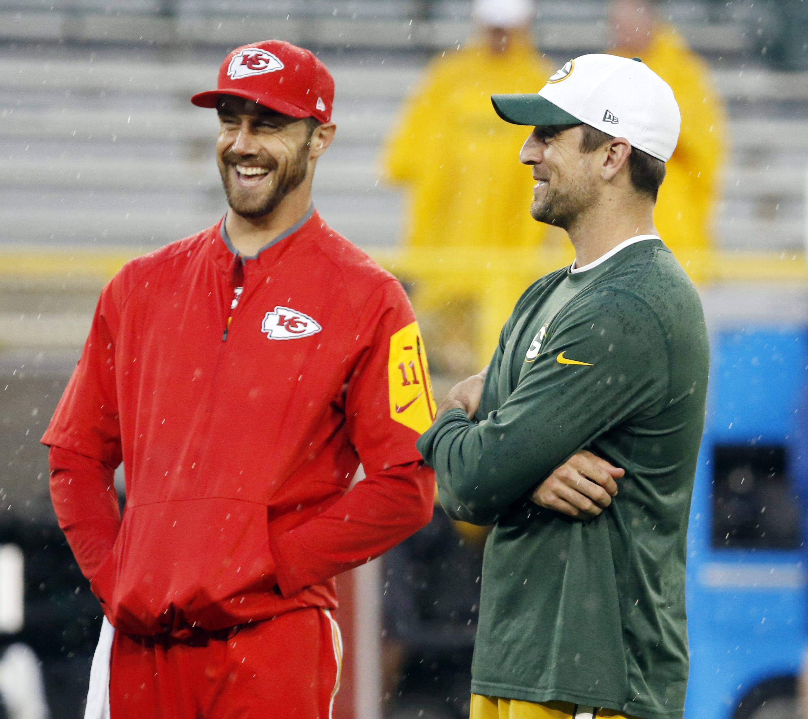 Green Bay Packers' Aaron Rodgers talks to Kansas City Chiefs' Alex Smith before an NFL football game Monday, Sept. 28, 2015, in Green Bay, Wis. (AP Photo/Mike Roemer)