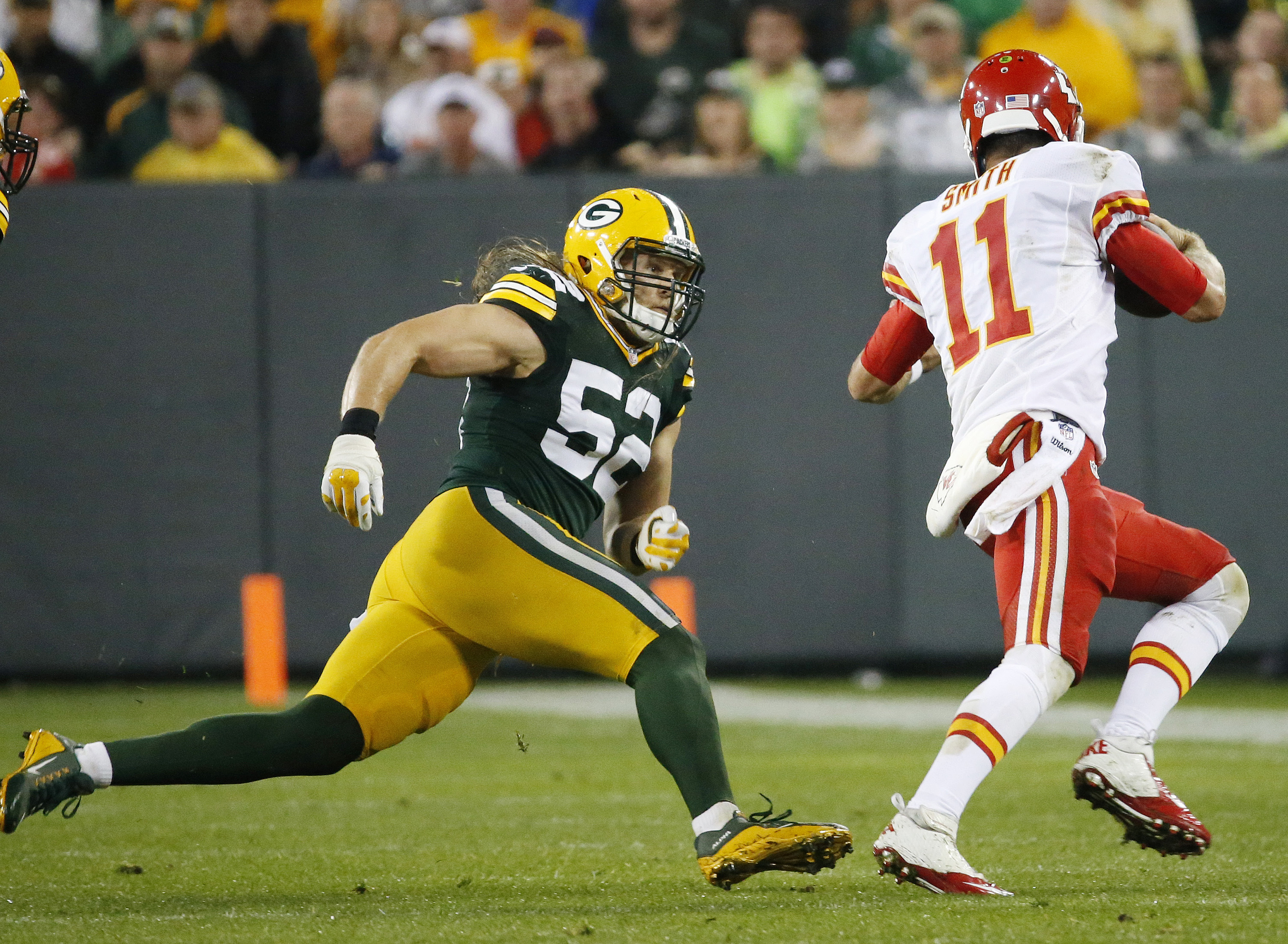 Green Bay Packers' Clay Matthews tries to catch Kansas City Chiefs' Alex Smith (11) during the second half of an NFL football game Monday, Sept. 28, 2015, in Green Bay, Wis. (AP Photo/Mike Roemer)