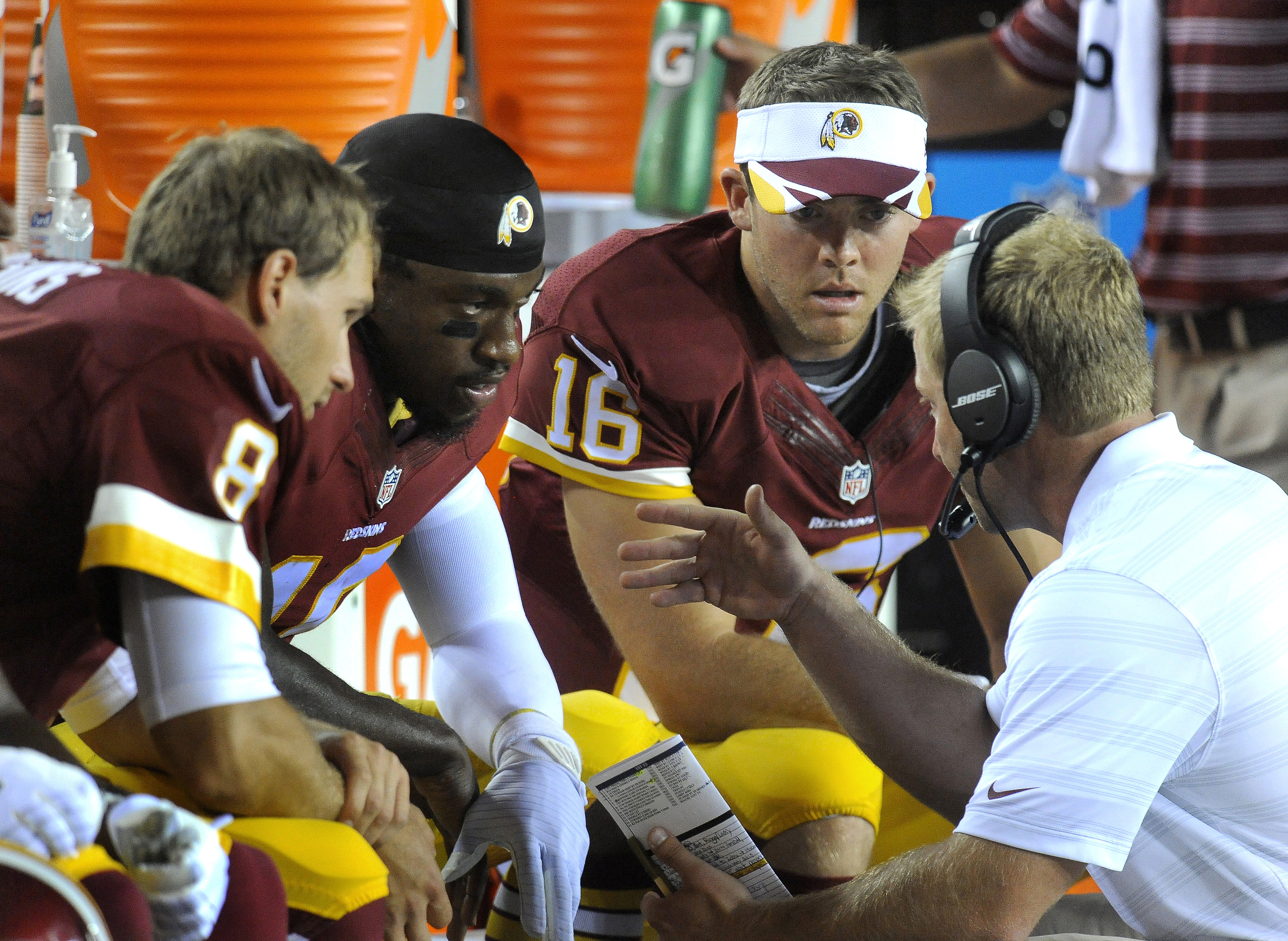 In this photo taken Aug. 19, 2014, Washington Redskins offensive coordinator Sean McVay, right, talks on the sidelines with his three quarterbacks, from left, Kirk Cousin (8), Robert Griffin III and Colt McCoy (16) during the second half of an NFL preseas