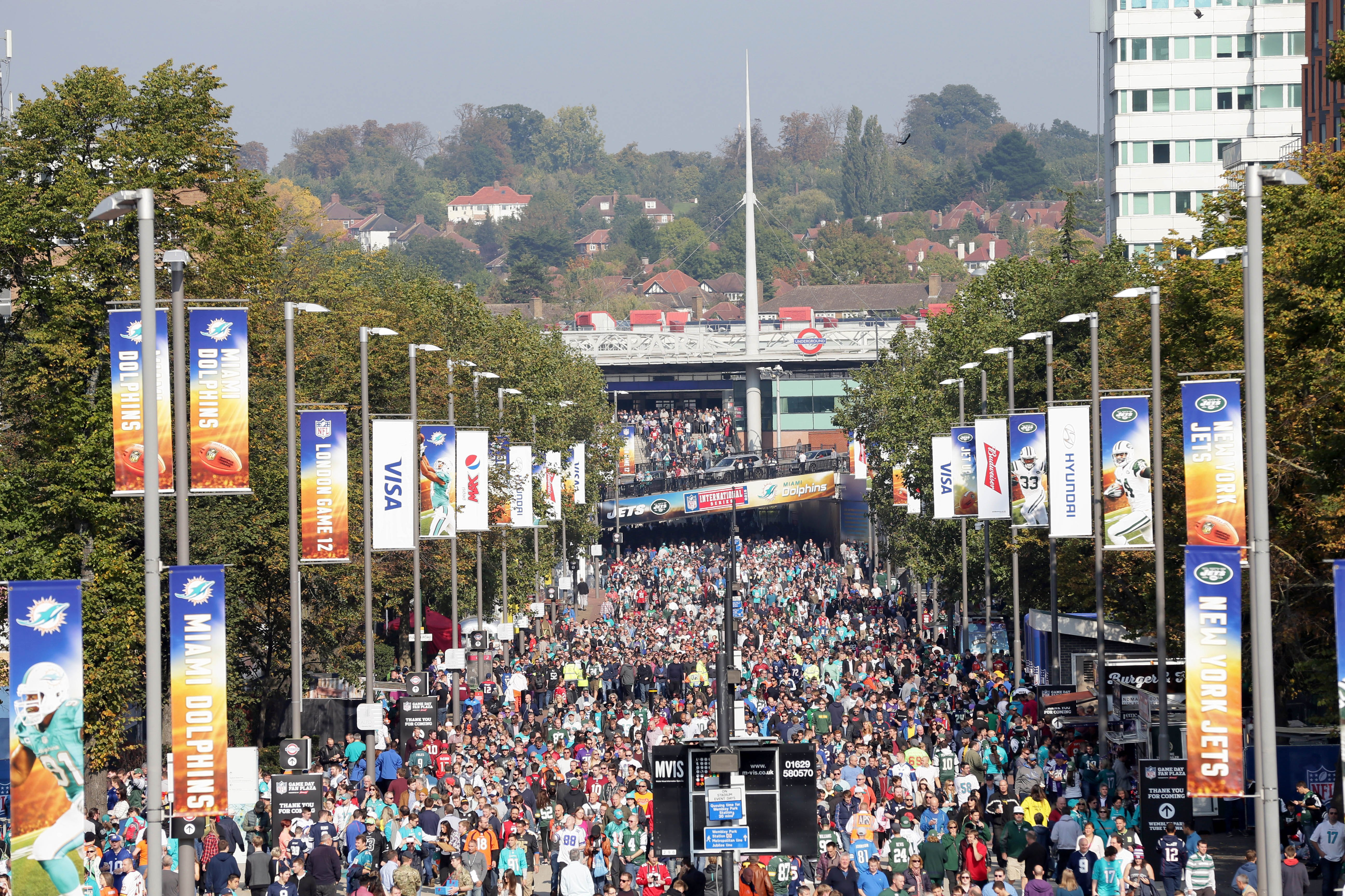 Spectators line Wembley Way as they arrive for the NFL football game between the New York Jets and the Miami Dolphins and at Wembley stadium in London, Sunday, Oct. 4, 2015. (AP Photo/Tim Ireland)