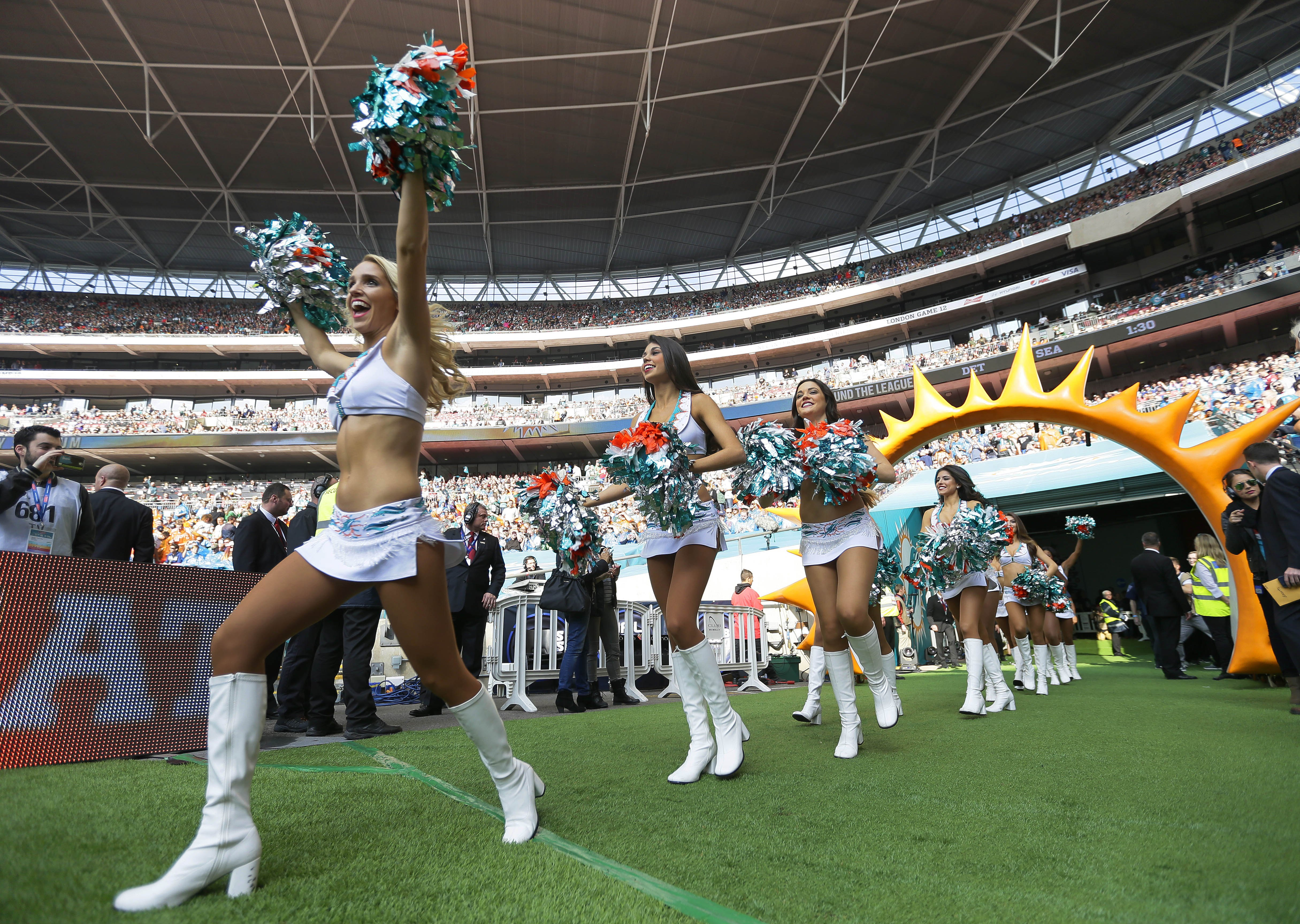 uDolphins cheerleaders come onto the field before the NFL football game between the New York Jets and the Miami Dolphins and at Wembley stadium in London, Sunday, Oct. 4, 2015.  (AP Photo/Tim Ireland)