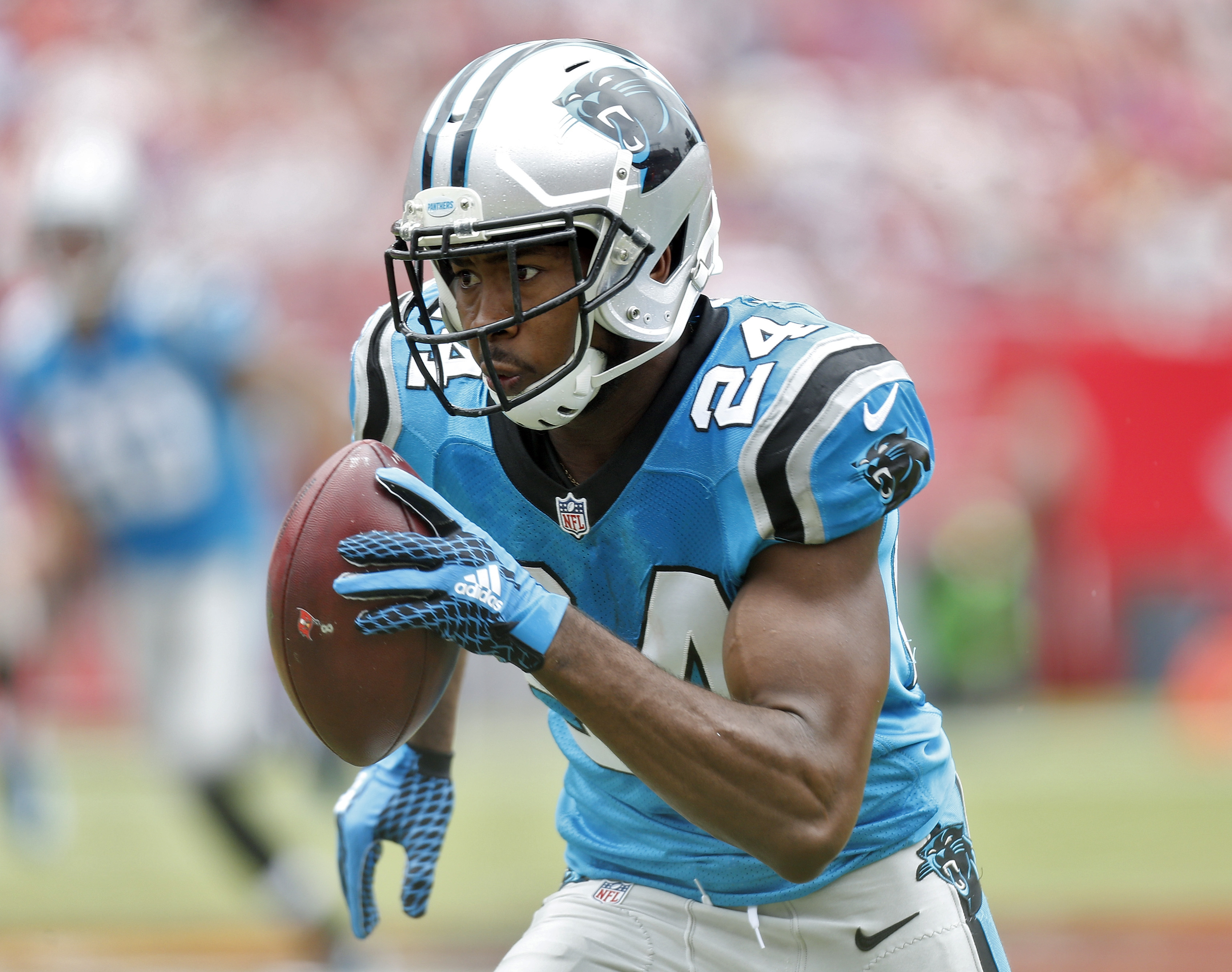 Carolina Panthers cornerback Josh Norman (24) heads for the end zone after intercepting a pass from Tampa Bay Buccaneers quarterback Jameis Winston during the first quarter of an NFL football game Sunday, Oct. 4, 2015, in Tampa, Fla. (AP Photo/Brian Blanc