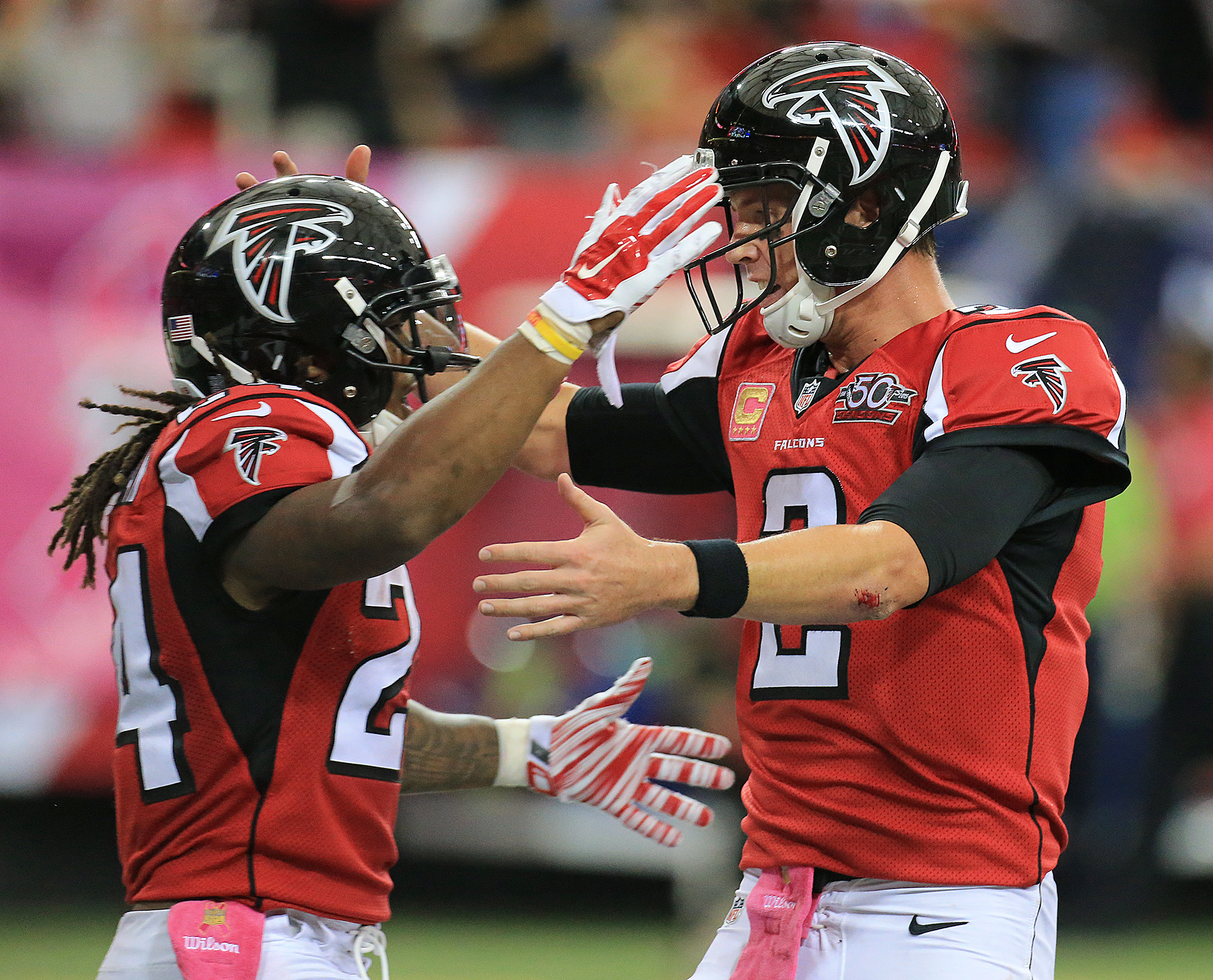Falcons running back Devonta Freeman, left, celebrates his second touchdown run of the day with quarterback Matt Ryan during the second quarter of their NFL football game against the Texans in Atlanta on Sunday, Oct. 4, 2015. (Curtis Compton/Atlanta Journ