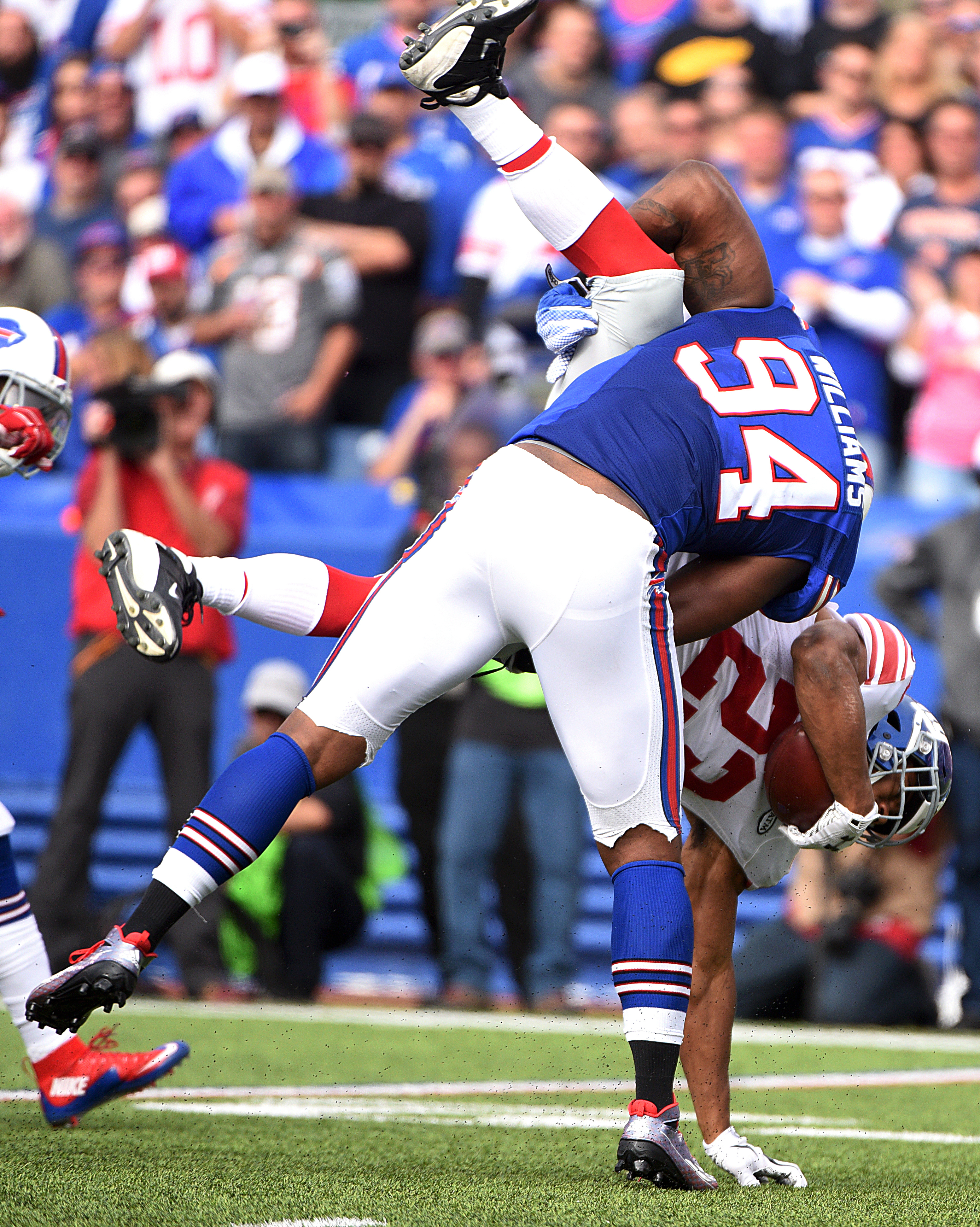 Buffalo Bills defensive end Mario Williams (94) drives New York Giants running back Rashad Jennings (23) to the ground during a tackle in the second half of an NFL football game, Sunday, Oct. 4, 2015, in Orchard Park, N.Y. (AP Photo/Gary Wiepert)