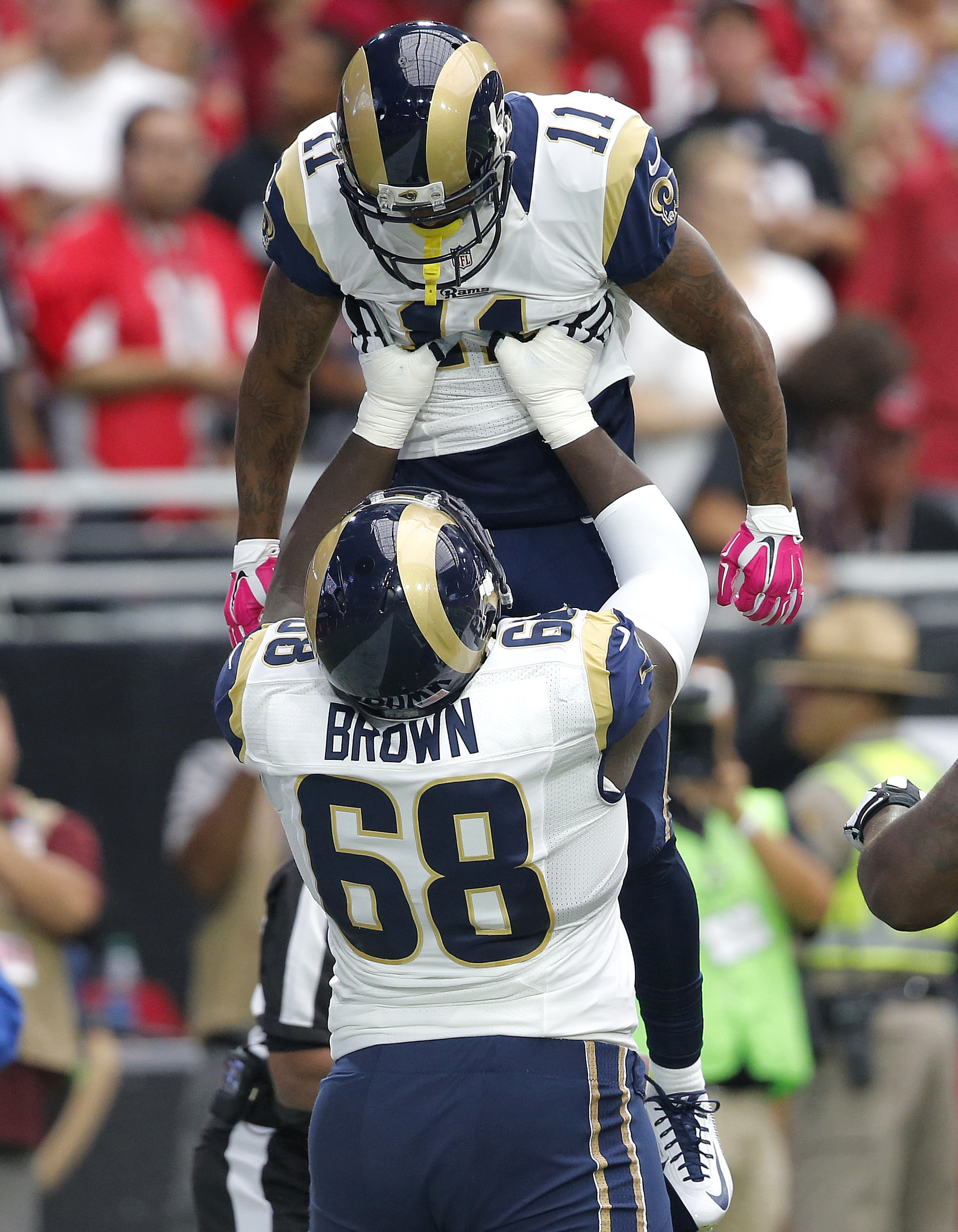 St. Louis Rams offensive guard Jamon Brown (68) lifts wide receiver Tavon Austin (11) after Austin scored a touchdown against the Arizona Cardinals during the first half of an NFL football game, Sunday, Oct. 4, 2015, in Glendale, Ariz. (AP Photo/Ross D. F