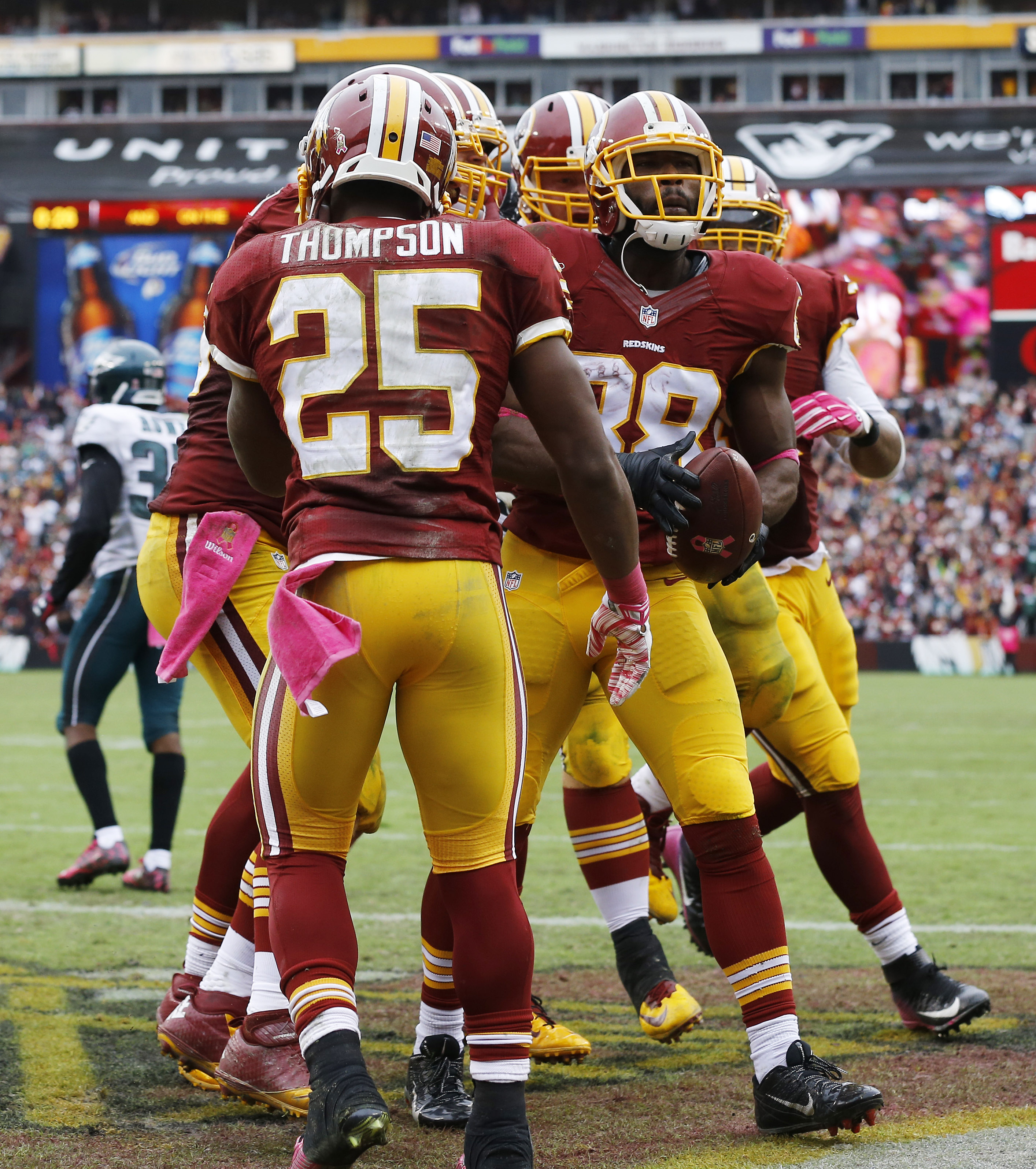 Washington Redskins wide receiver Pierre Garcon (88) celebrates his touchdown with teammates during the second half of an NFL football game against the Philadelphia Eagles in Landover, Md., Sunday, Oct. 4, 2015. The Redskins defeated the Eagles 23-20. (AP