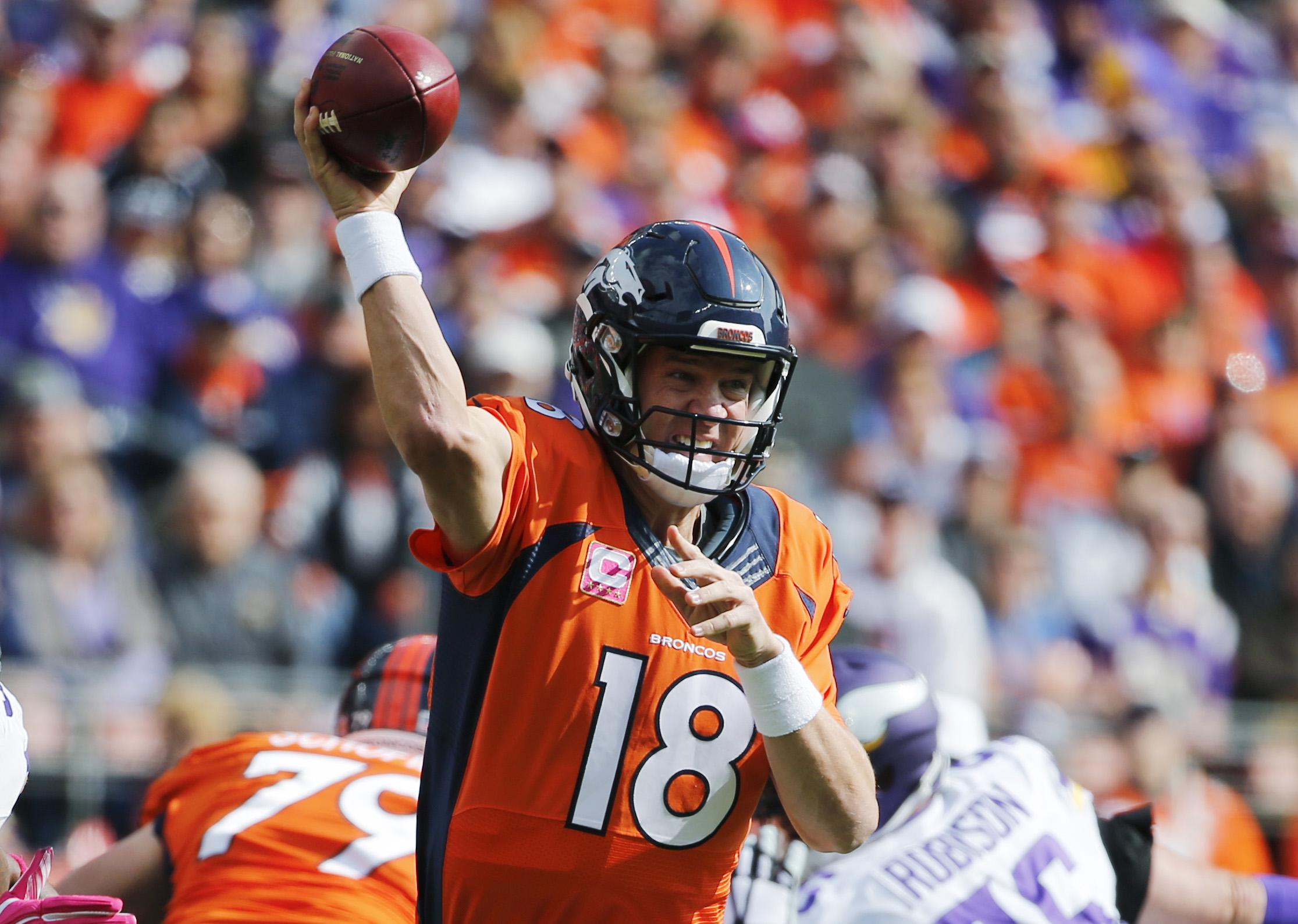 Denver Broncos quarterback Peyton Manning passes against the Minnesota Vikings during the first half of an NFL football game, Sunday, Oct. 4, 2015, in Denver. (AP Photo/Jack Dempsey)