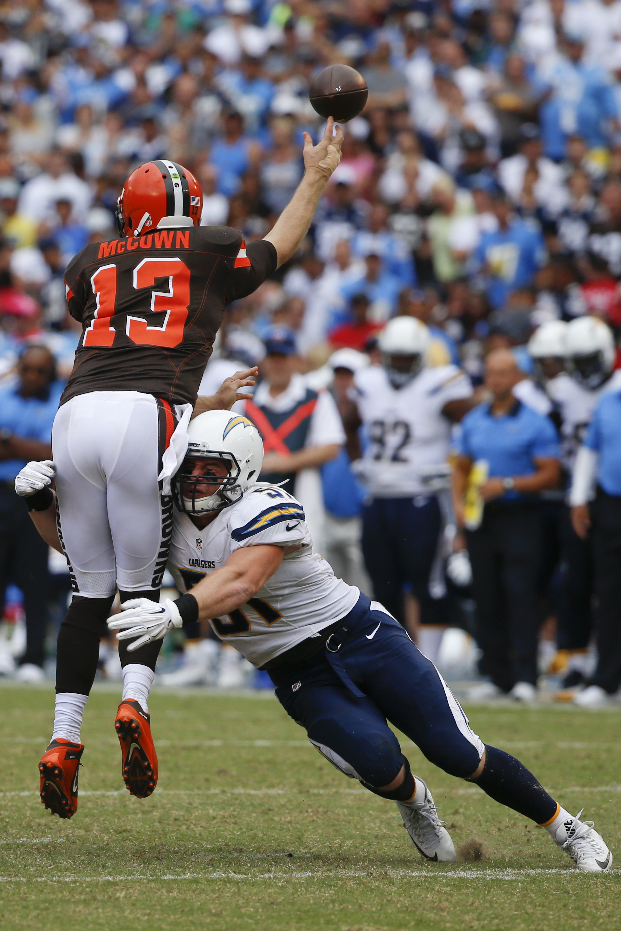 Cleveland Browns quarterback Josh McCown (13) is hit by San Diego Chargers outside linebacker Kyle Emanuel as he throws a pass during the second half in an NFL football game Sunday, Oct. 4, 2015, in San Diego. (AP Photo/Lenny Ignelzi)