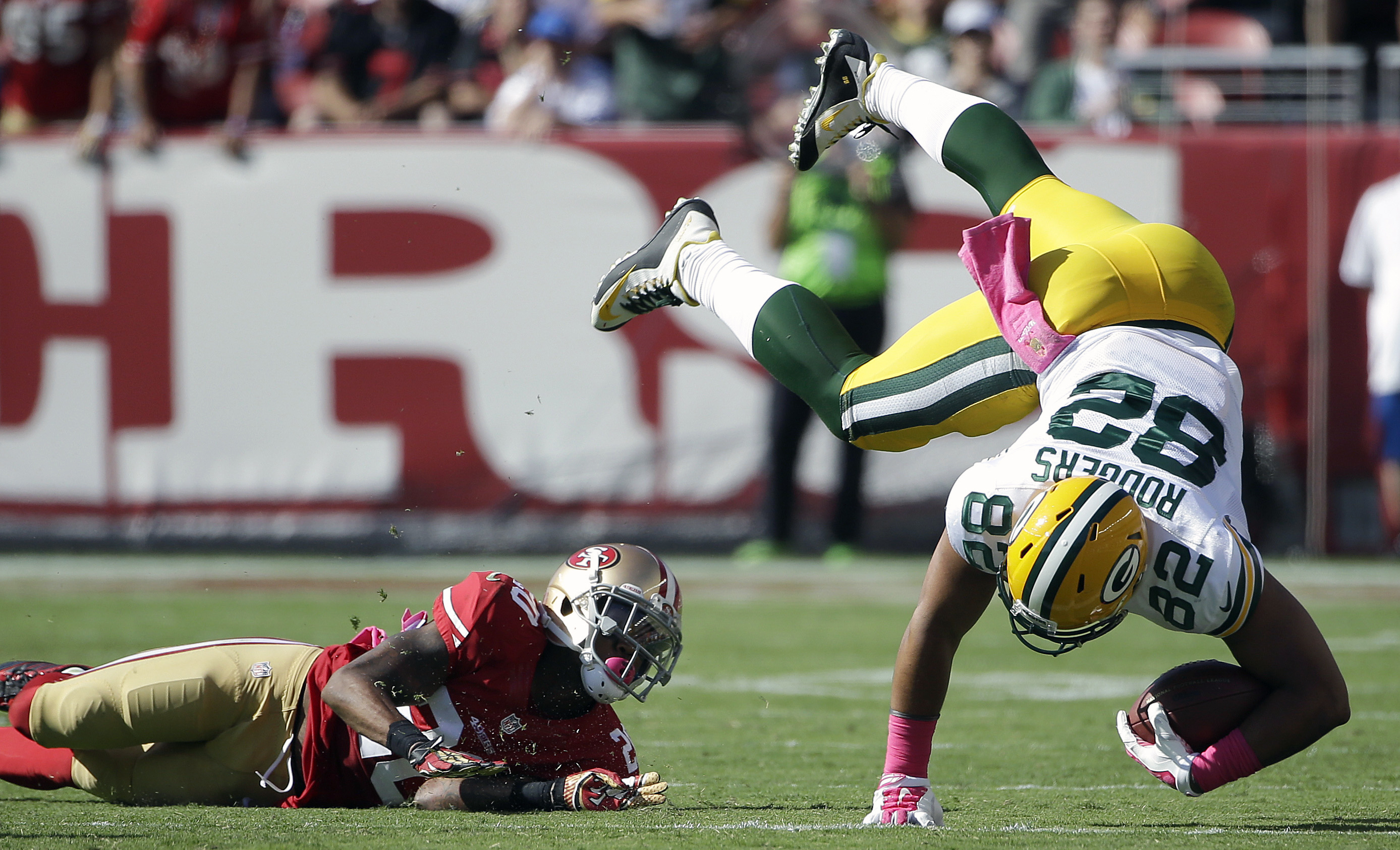 Green Bay Packers tight end Richard Rodgers (82) is tackled by San Francisco 49ers cornerback Kenneth Acker (20) during the second half of an NFL football game in Santa Clara, Calif., Sunday, Oct. 4, 2015. (AP Photo/Marcio Jose Sanchez)