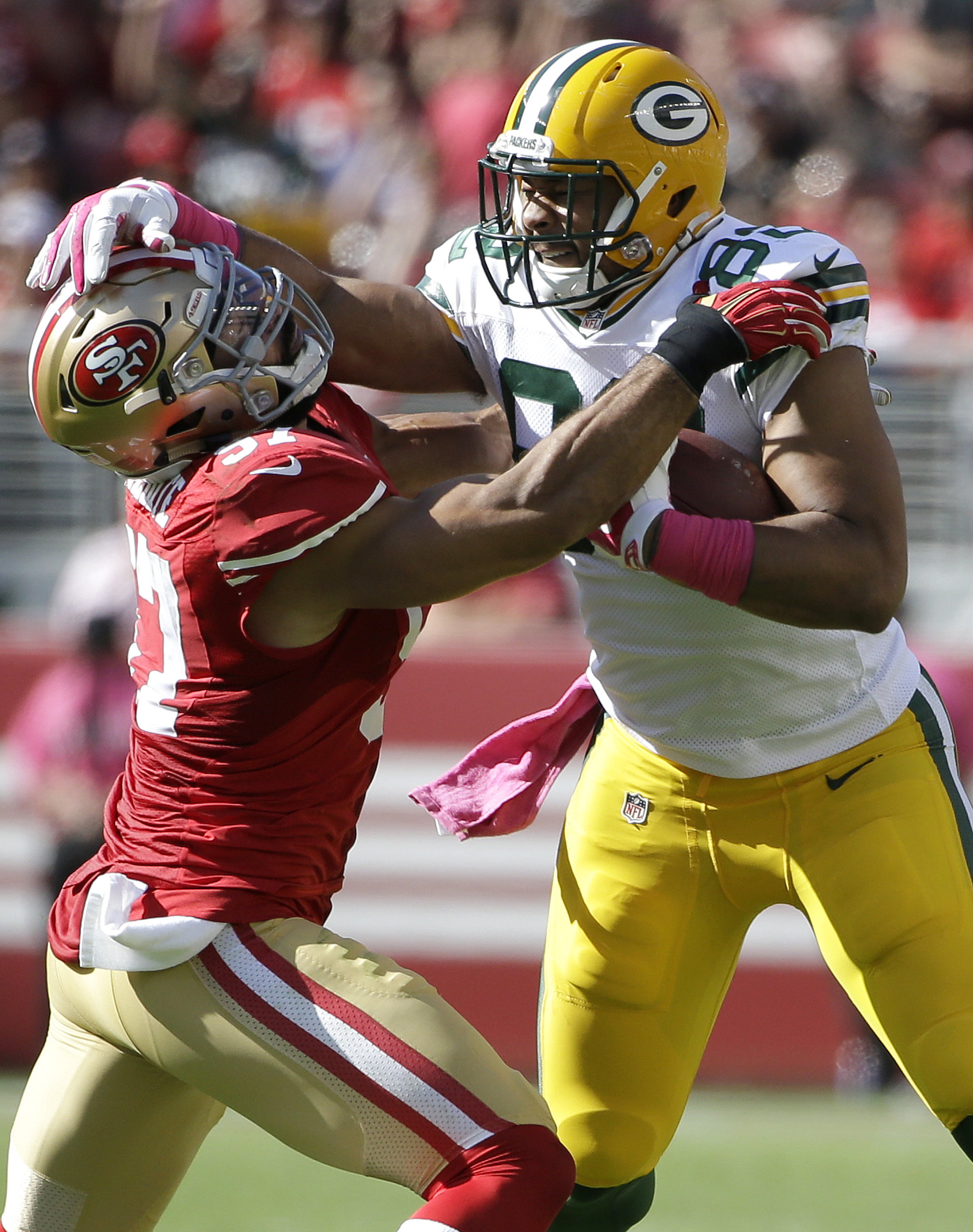 Green Bay Packers tight end Richard Rodgers (82) runs against San Francisco 49ers linebacker Michael Wilhoite (57) during the second half of an NFL football game in Santa Clara, Calif., Sunday, Oct. 4, 2015. (AP Photo/Marcio Jose Sanchez)