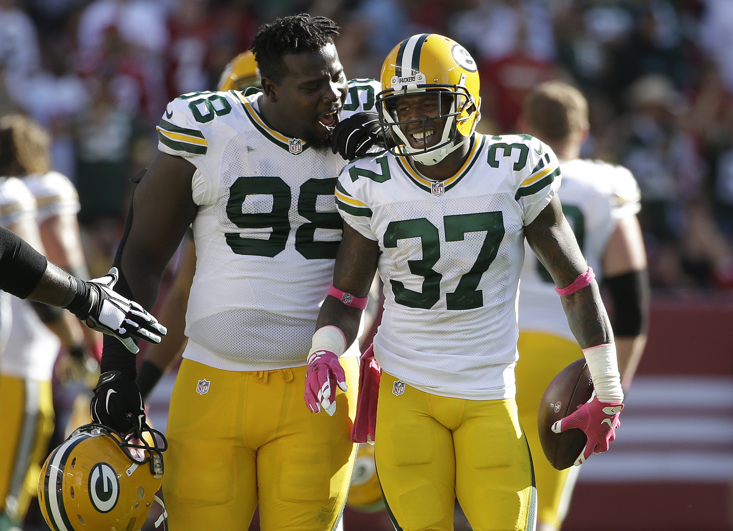 Green Bay Packers cornerback Sam Shields (37) celebrates with nose tackle Letroy Guion (98) after intercepting a pass from San Francisco 49ers quarterback Colin Kaepernick during the second half of an NFL football game in Santa Clara, Calif., Sunday, Oct.