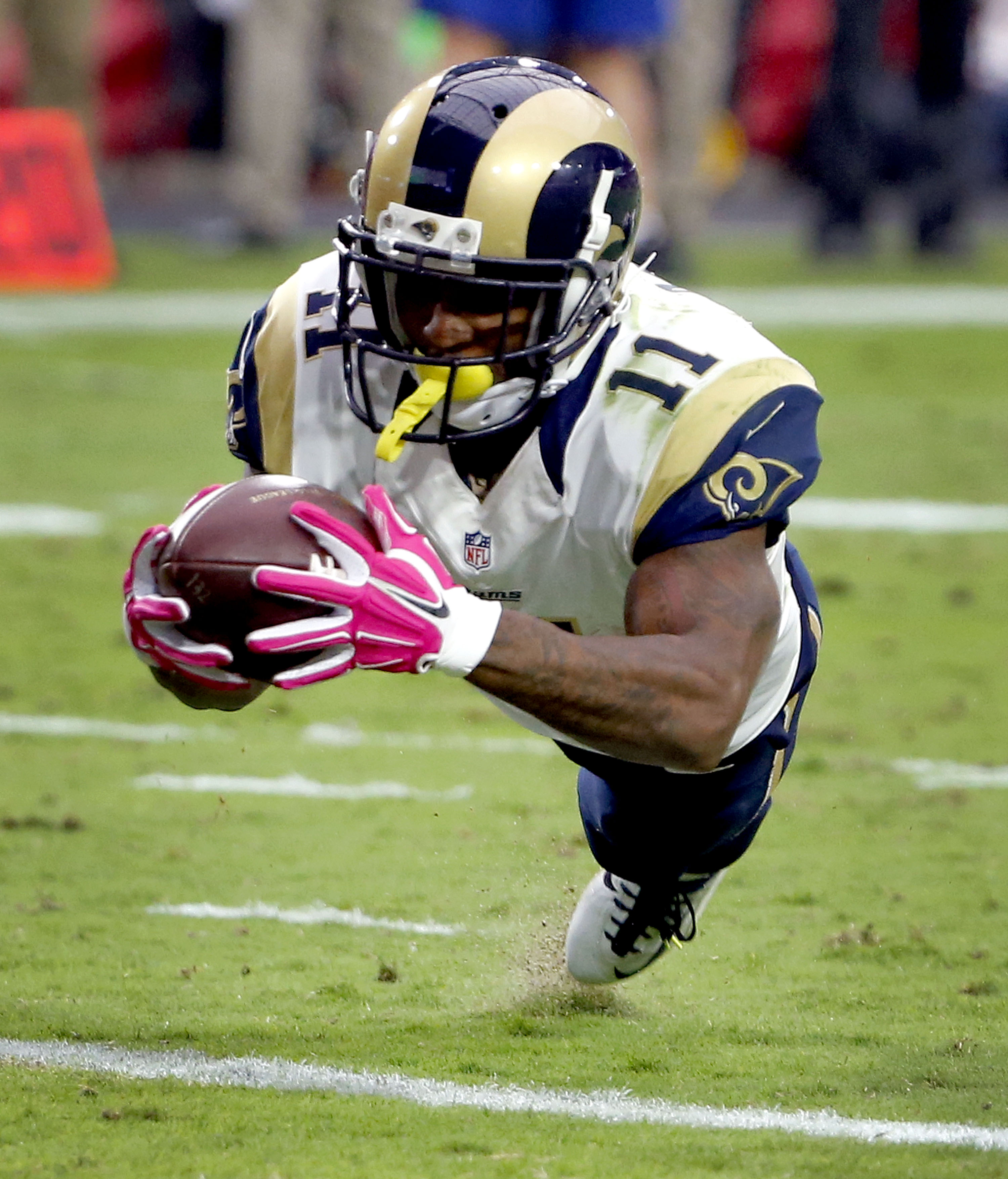 St. Louis Rams wide receiver Tavon Austin (11) lunges for the end zone for a touchdown against the Arizona Cardinals during the second half of an NFL football game, Sunday, Oct. 4, 2015, in Glendale, Ariz. (AP Photo/Ross D. Franklin)