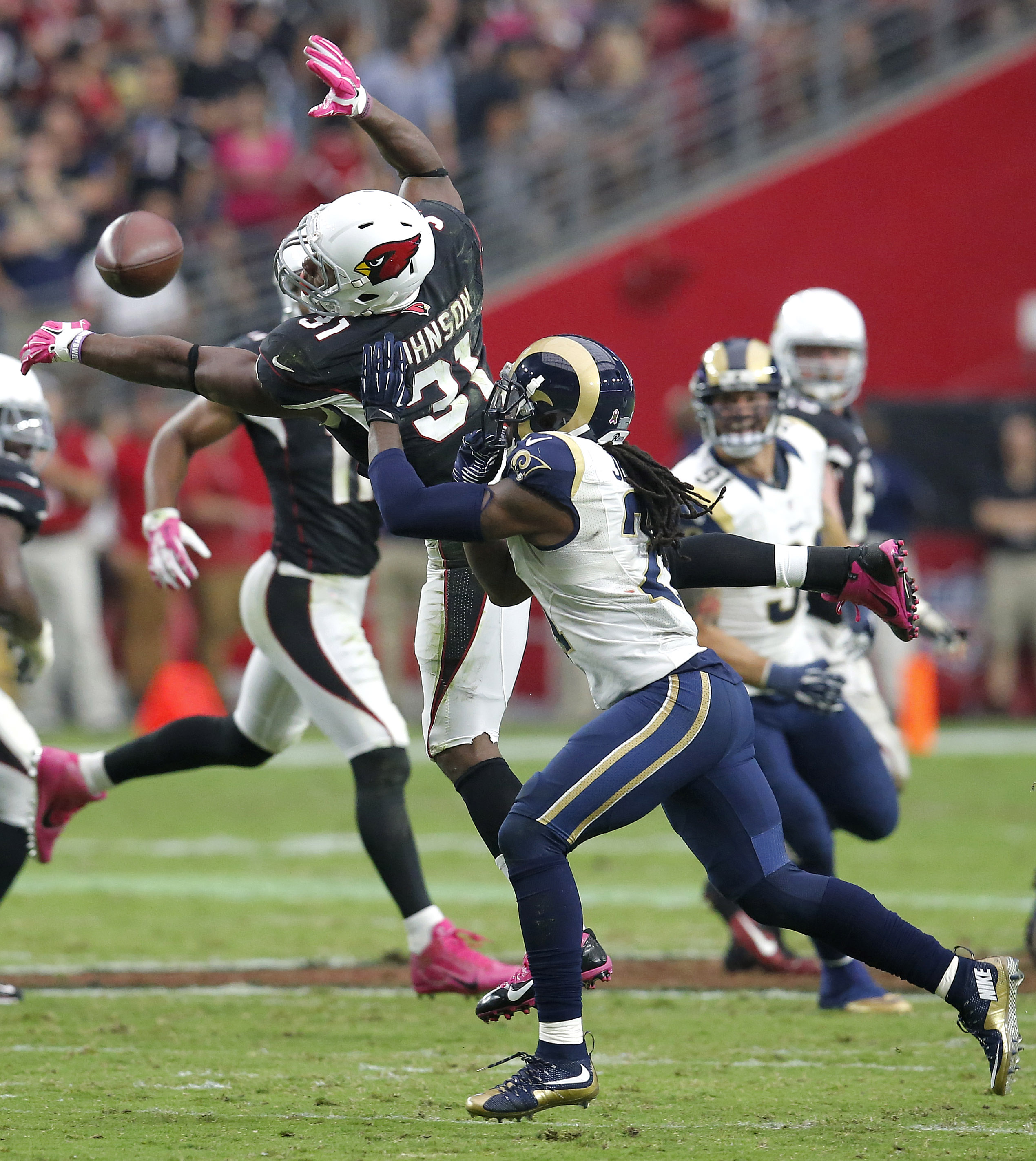 Arizona Cardinals running back David Johnson (31) can't make the catch on fourth down as St. Louis Rams cornerback Janoris Jenkins (21) defends the second half of an NFL football game, Sunday, Oct. 4, 2015, in Glendale, Ariz. The Rams won 24-22. (AP Photo