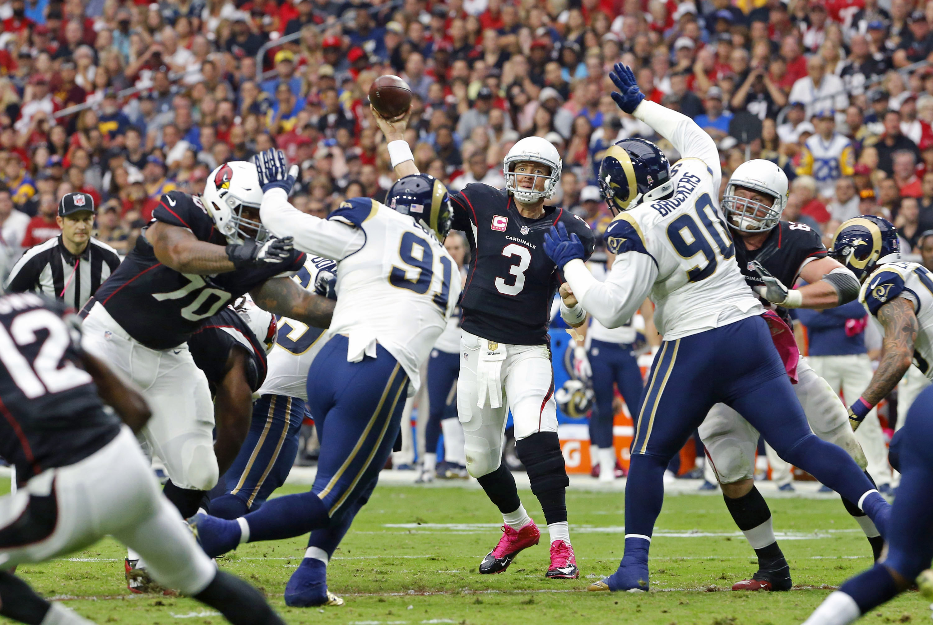 Arizona Cardinals quarterback Carson Palmer (3) throws under pressure against the St. Louis Rams during the first half of an NFL football game, Sunday, Oct. 4, 2015, in Glendale, Ariz. (David Kadlubowski/The Arizona Republic via AP)  MARICOPA COUNTY OUT;
