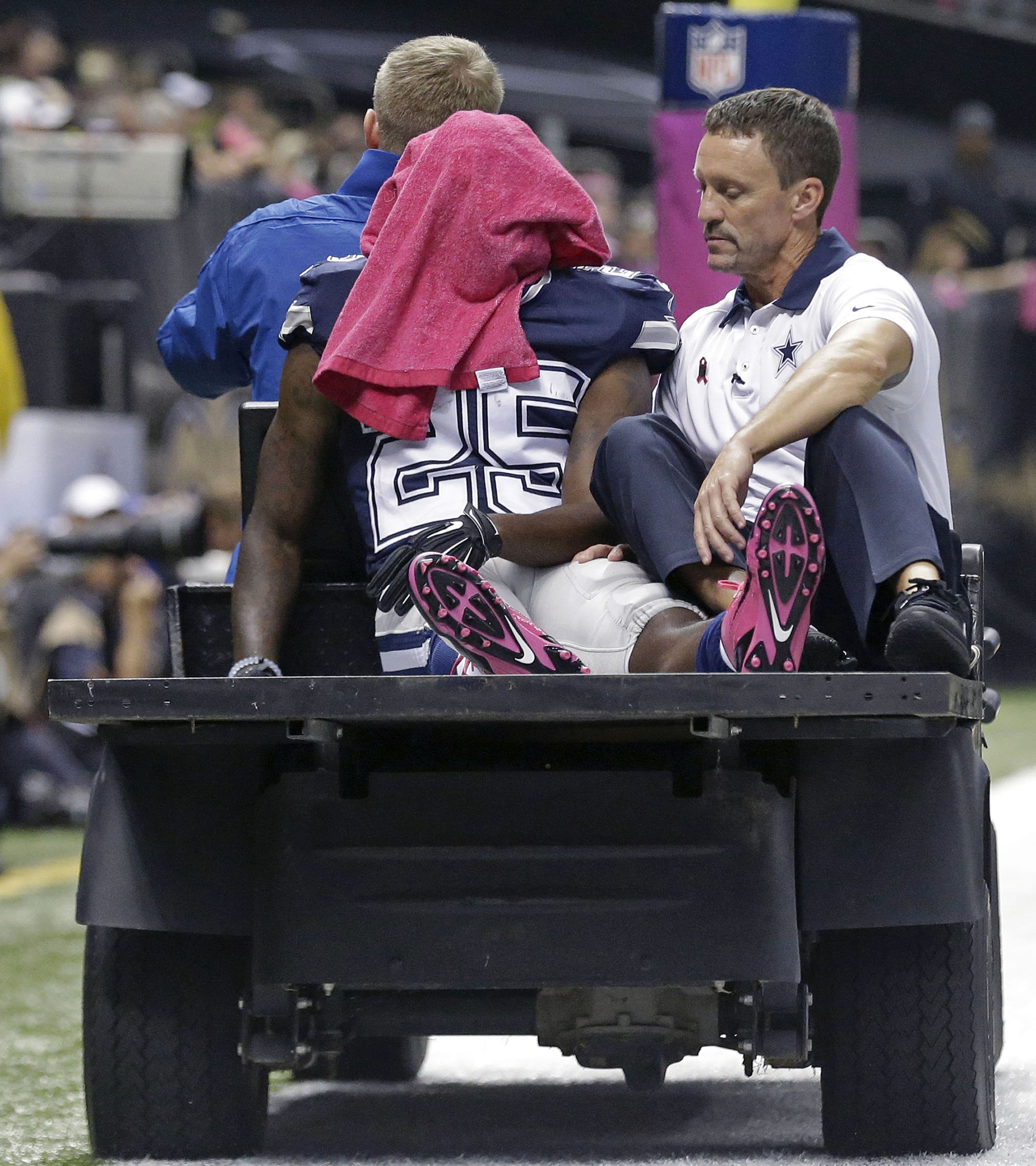 Dallas Cowboys running back Lance Dunbar (25) is carted off the field in the second half of an NFL football game against the New Orleans Saints in New Orleans, Sunday, Oct. 4, 2015. (AP Photo/Brynn Anderson)