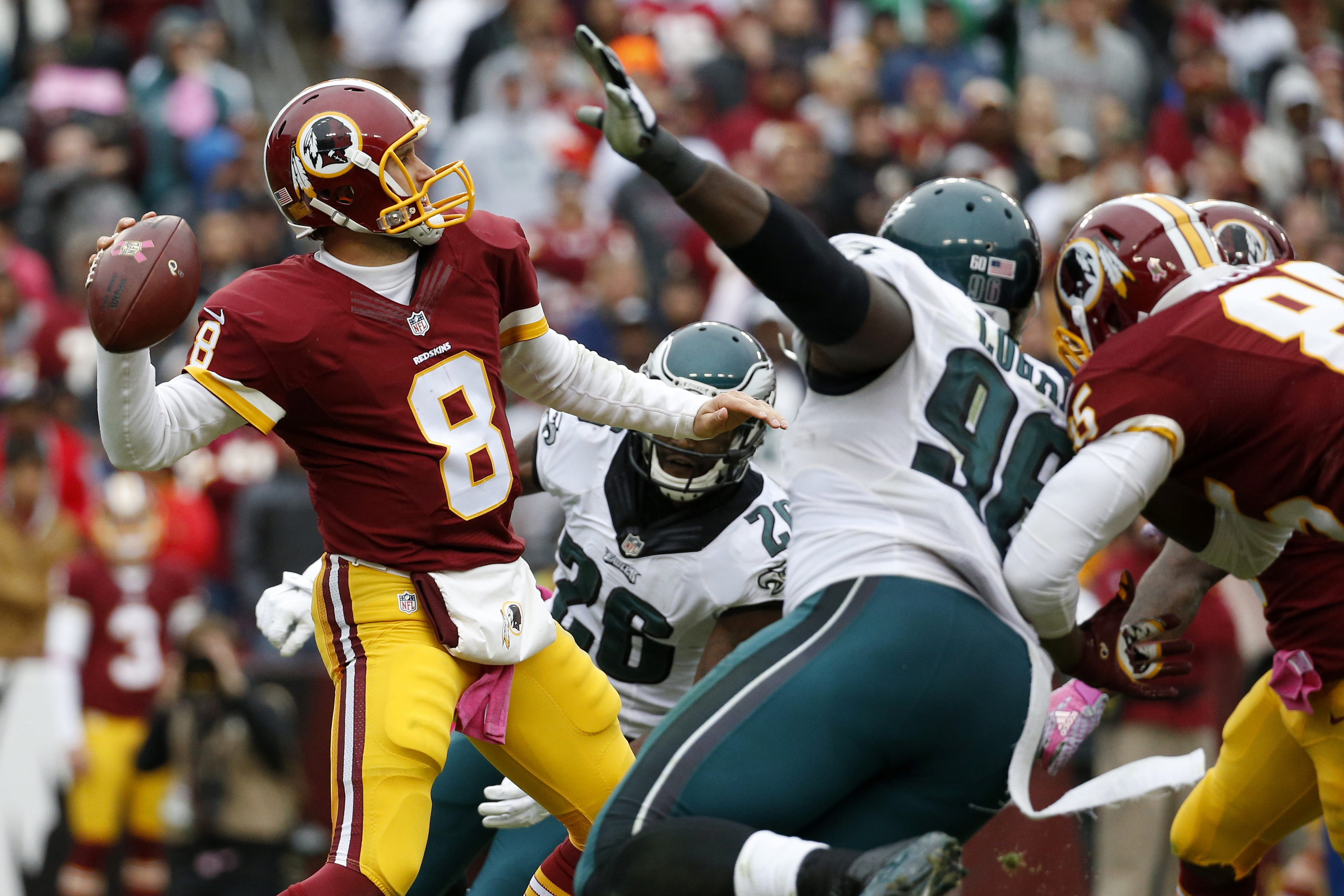 In this photo taken Oct. 4, 2015, Washington Redskins quarterback Kirk Cousins (8) passes the ball during the second half of an NFL football game against the Philadelphia Eagles in Landover, Md. After six last-place finishes in the past seven seasons, spe