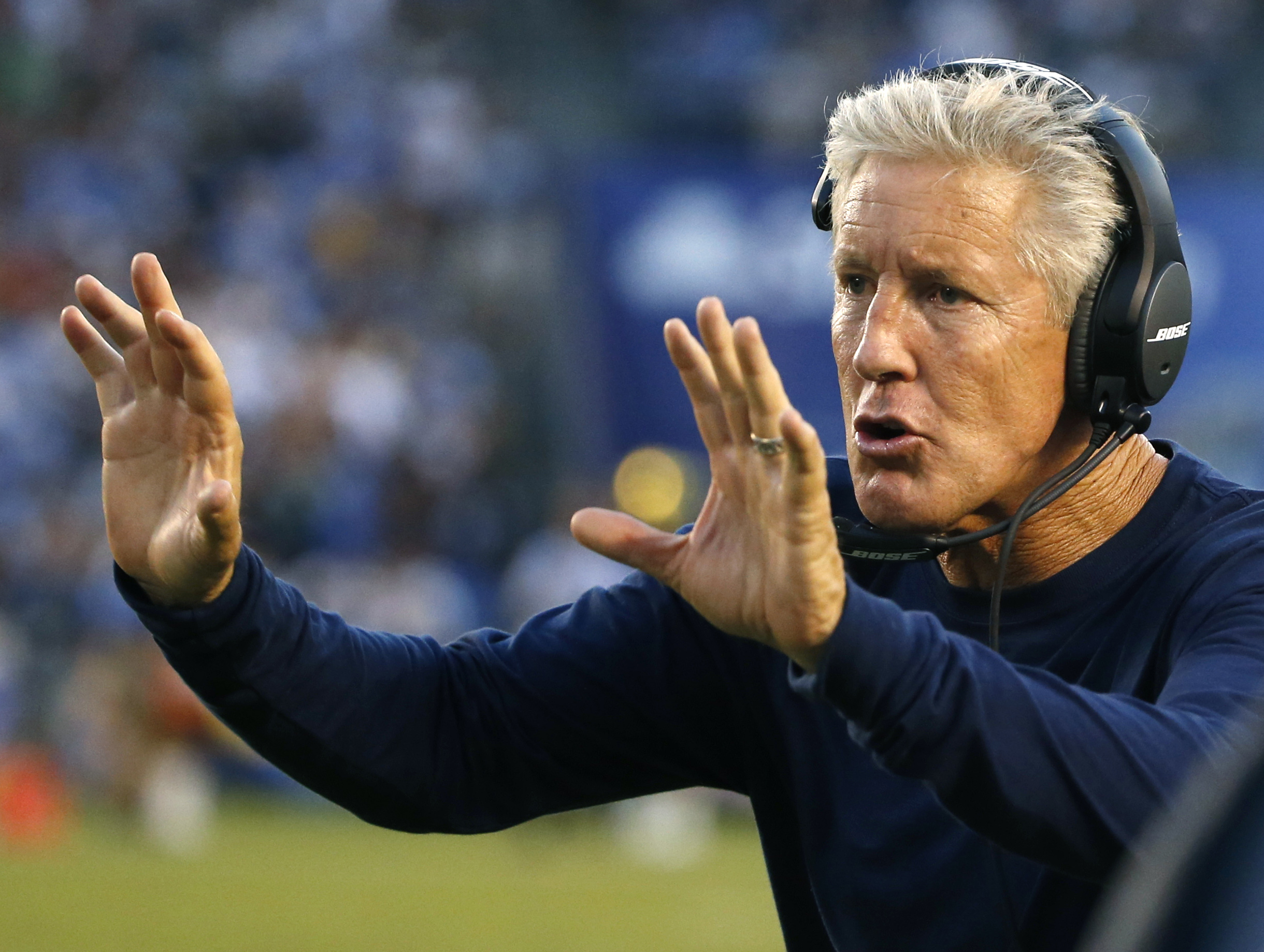 FILE - In this Aug. 29, 2015, file photo, Seattle Seahawks head coach Pete Carroll yells to his team during the second half of a preseason NFL football game against the San Diego Chargers in San Diego. As part of the program he has constructed in Seattle,